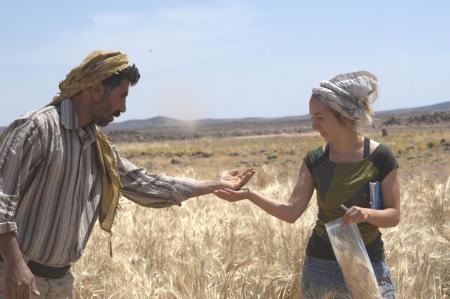 Amaia Arranz-Otaegui, a lead author on the paper about the bread discovery, and Ali Shakaiteer, a local assistant to the researchers, sample cereals in the Shubayqa area.