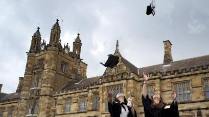 University students toss their graduation hats into the air for friends and family to take photos following their graduation ceremony at University of Sydney in Sydney, Australia, April 22, 2016.