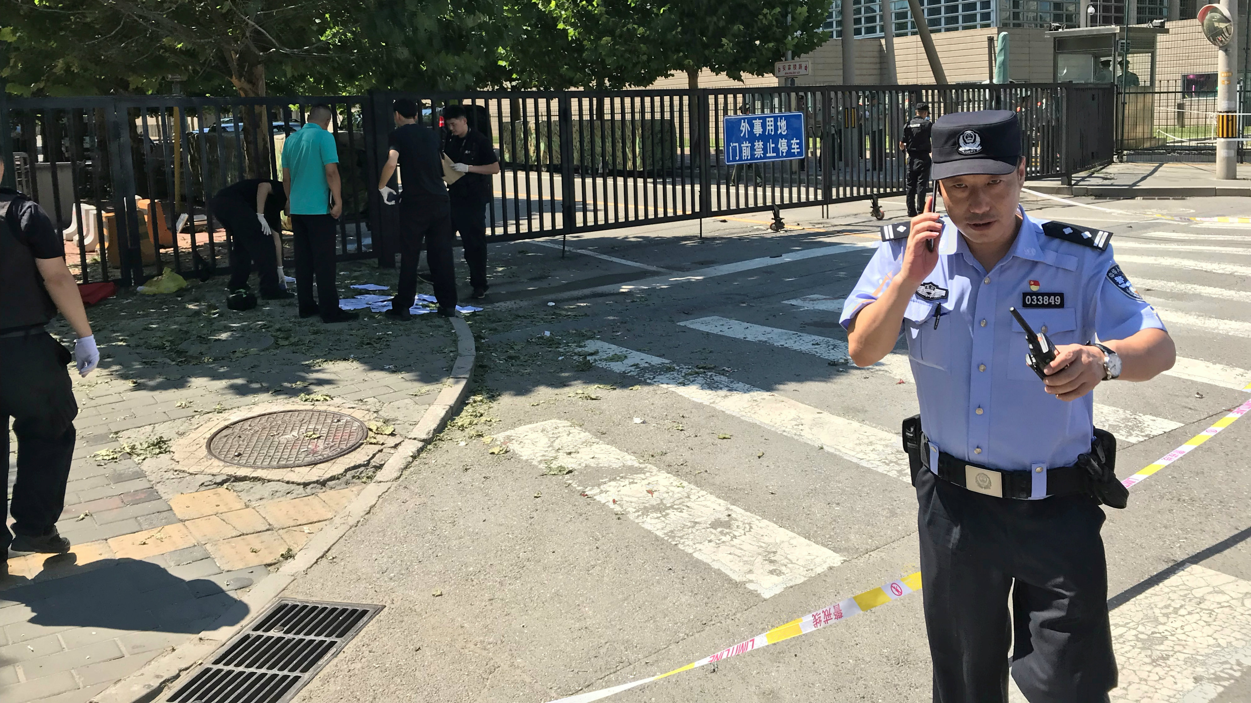 A police officer is seen near the U.S. embassy in Beijing, China July 26, 2018.