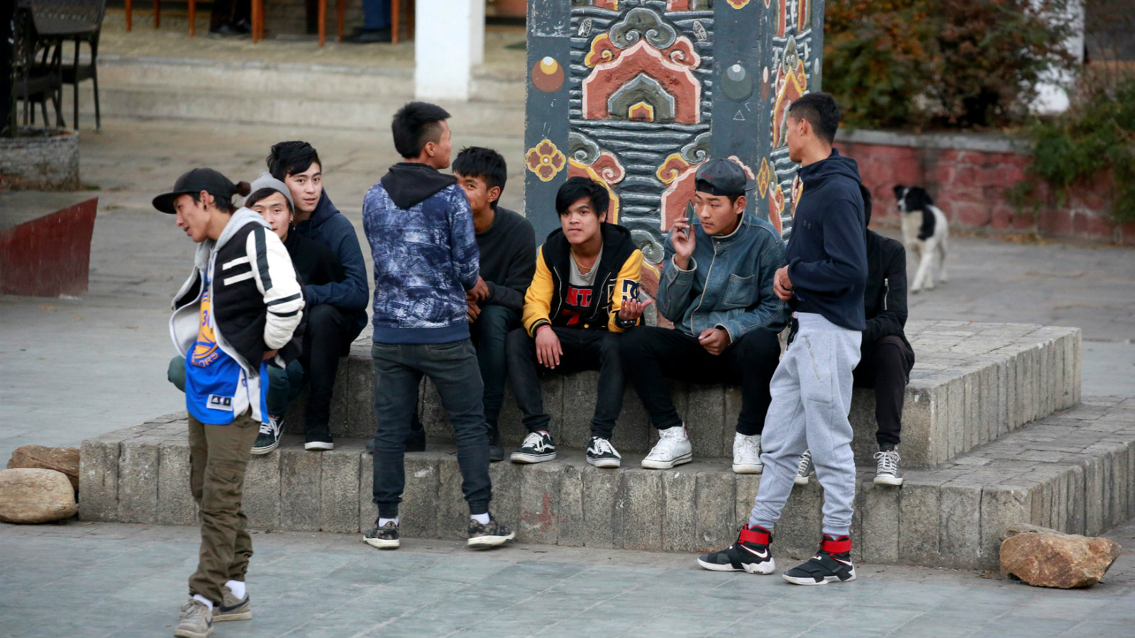 Youths sit around the central square in the capital city of Thimphu, Bhutan, December 12, 2017.