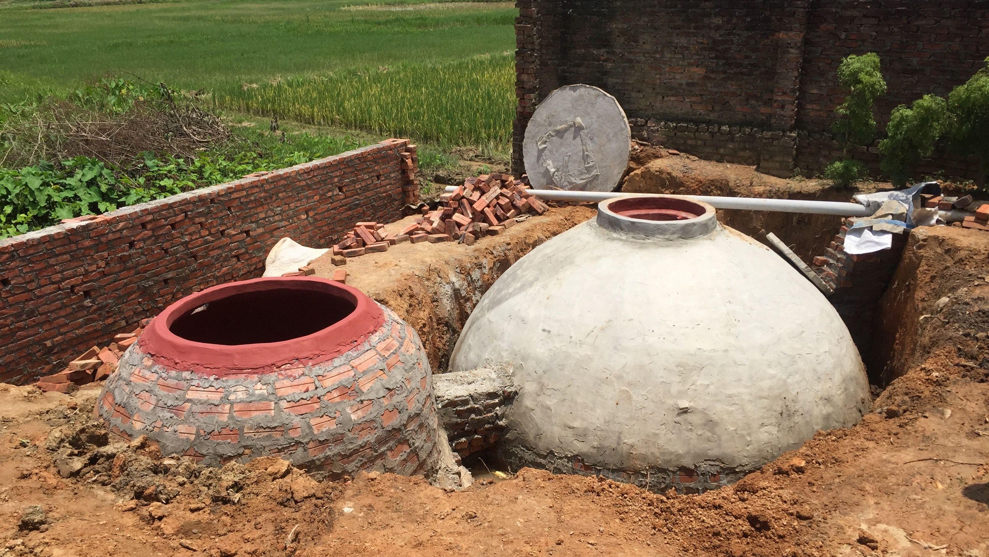 Two recently-built digesters in Hanoi, Vietnam.