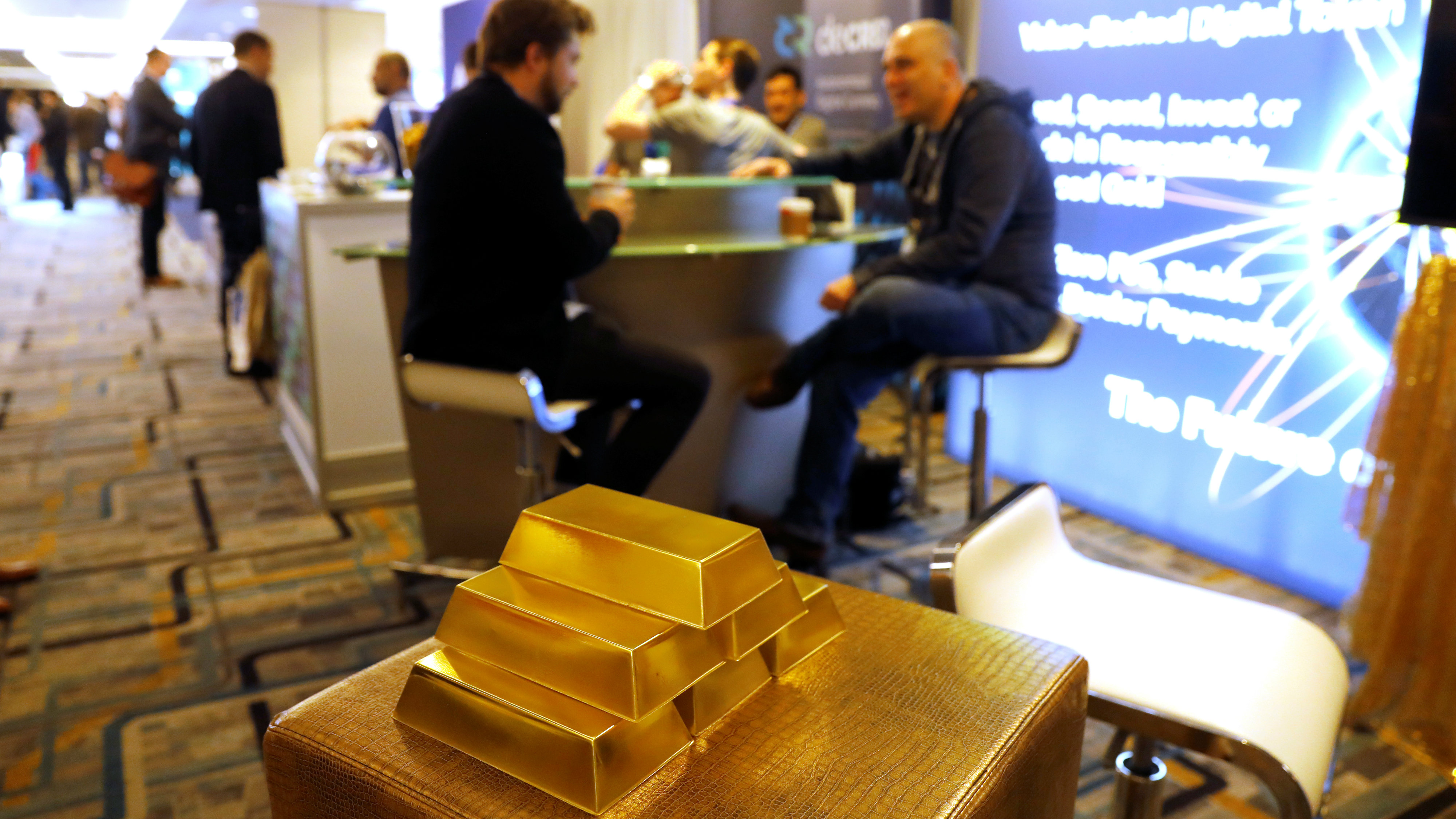 Imitation gold bars are seen displayed at a vendor's booth on the floor of the Consensus 2018 blockchain technology conference in New York City, New York, U.S., May 16, 2018.