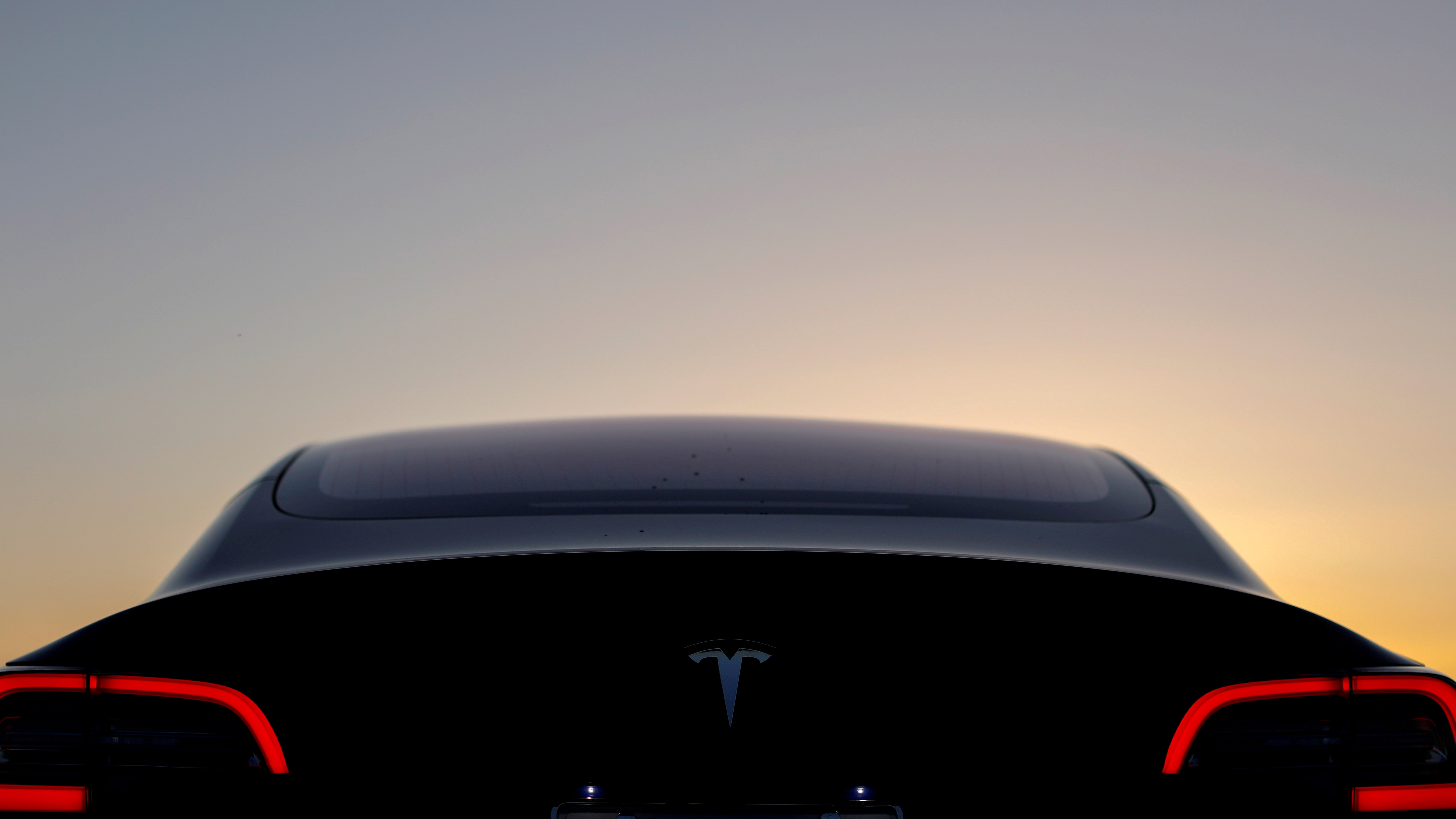 FILE PHOTO: A 2018 Tesla Model 3 electric vehicle is shown in this photo illustration taken in Cardiff, California, U.S., June 1, 2018.  REUTERS/Mike Blake/File Photo - RC14CA00E2F0