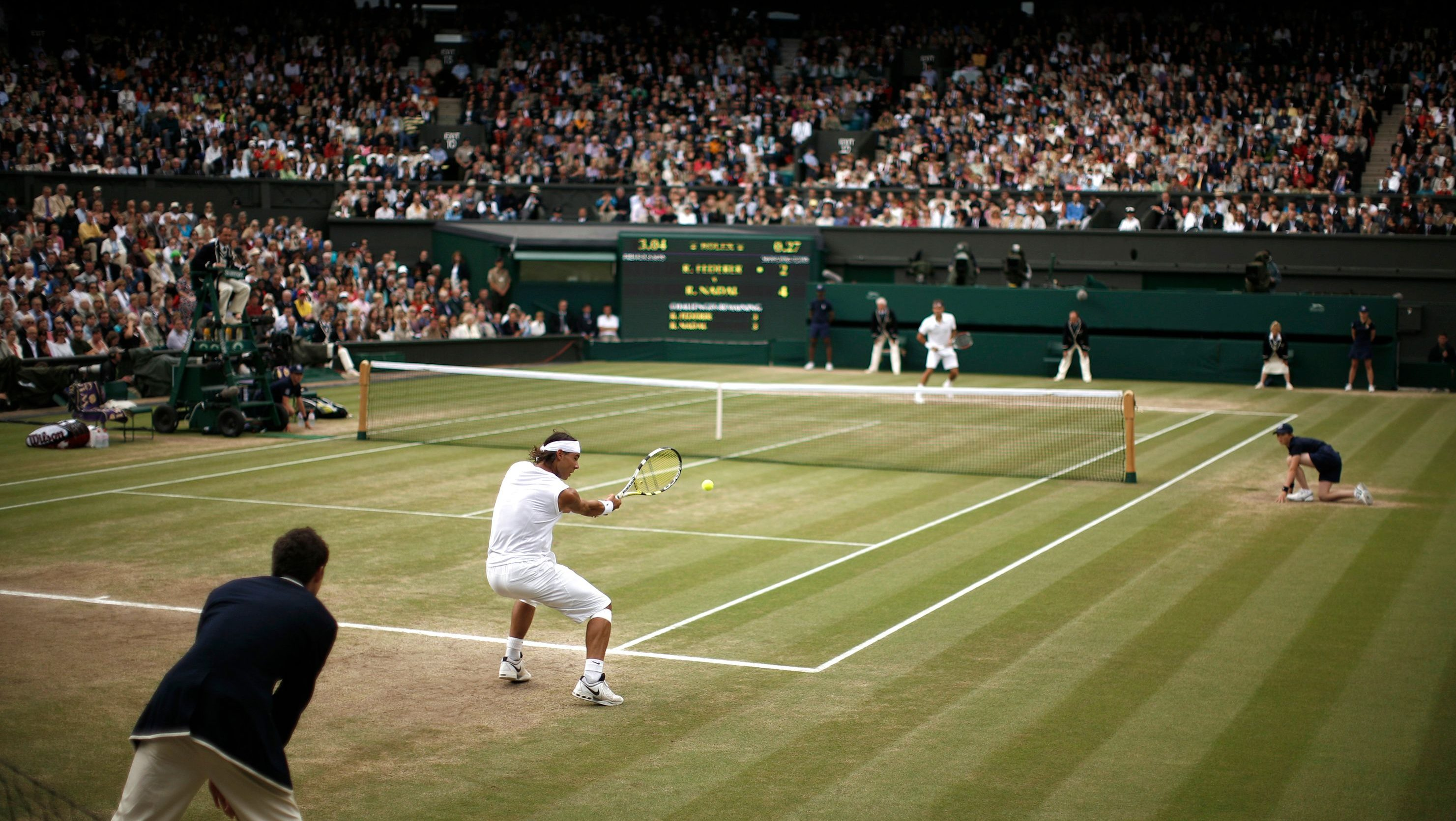 Rafael Nadal of Spain returns the ball to Roger Federer of Switzerland during their finals match at the Wimbledon tennis championships in London July 6, 2008.