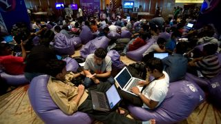 epa03356742 Indian software engineers take part in the 24-hours uninterrupted open hacking competition ?unrestrained innovation? in Southern Indian city of Bangalore on 11 August 2012.Over Hundreds of software engineers and developers from across Indian took part in the Yahoo Research and Development in the 5th Open Hack in India, which gives Hackers team a platform to show their skill and gives developers a chance to work together and turn their ideas into a working prototype or ?Hack?.  EPA/JAGADEESH NV