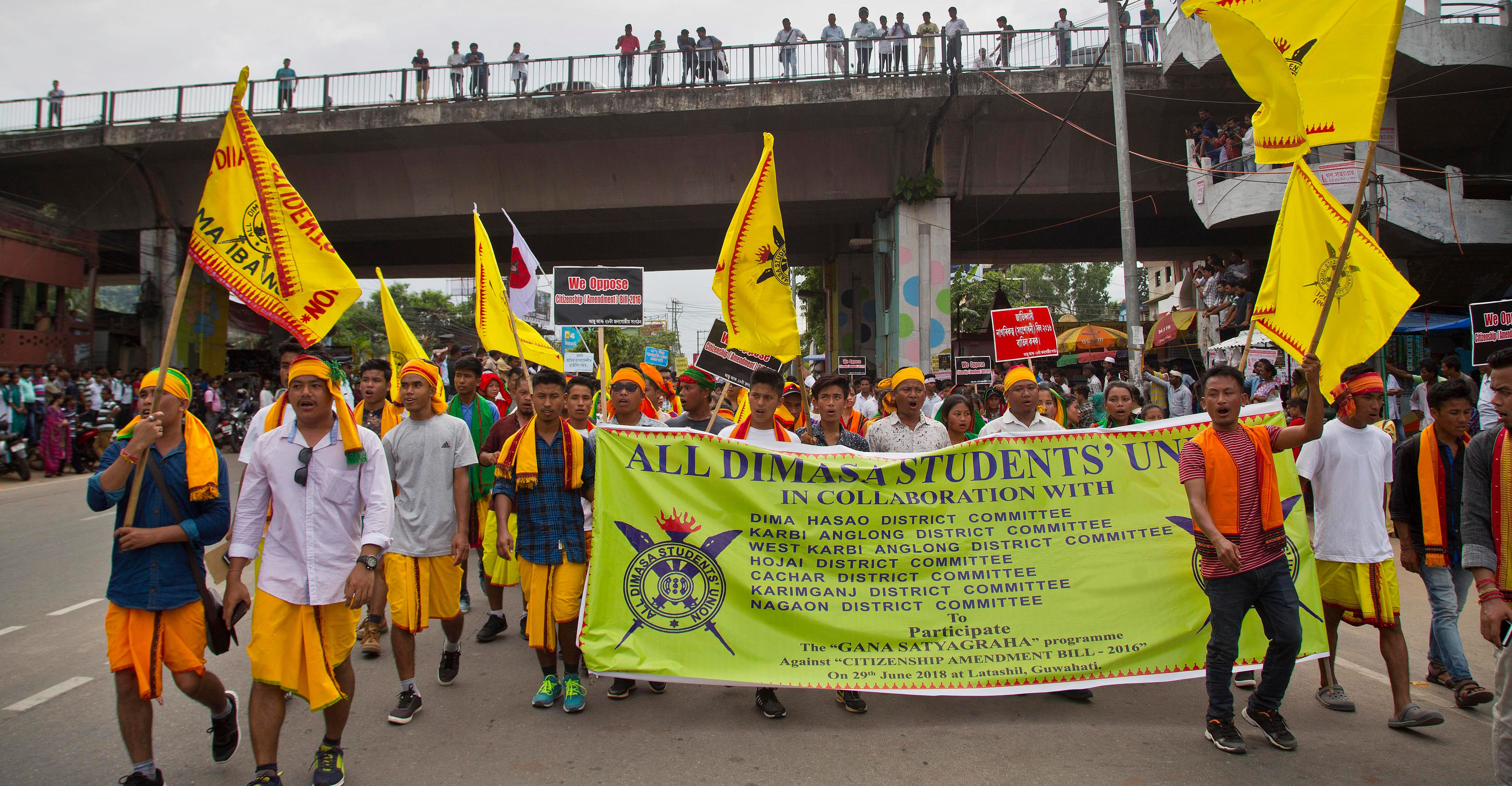 epa06849750 Activists of All Assam Students' Union (AASU), along with 28 other organizations walk during a protest rally against India's Citizenship Amendment Bill 2016 in Guwahati, Assam, India, 29 June 2018. Hundreds of people protesting against a bill by the Indian government that provide citizenship to illegal migrants from Afghanistan, Bangladesh, and Pakistan, who are of Hindu, Sikh, Buddhist, Jain, Parsi, or Christian but doesn?t have a provision for Muslim sects, a news report said.