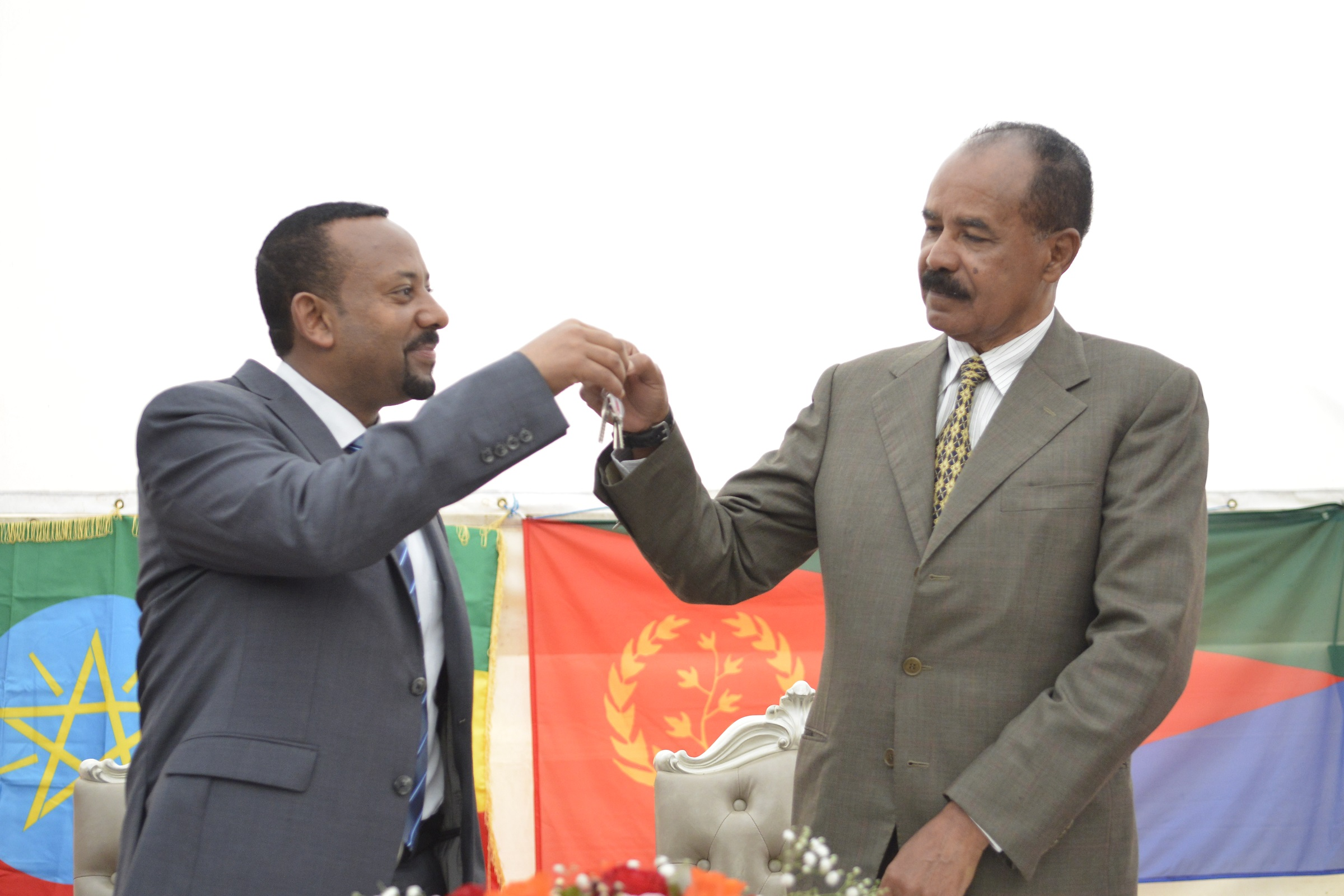Ethiopia's Prime Minister Abiy Ahmed (L) and Eritrea's President Isaias Afwerki (R) attend the re-opening of the Eritrean embassy in the Ethiopian capital Addis Ababa, Ethiopia, in a brief ceremony 16 July 2018. The leaders declared their 'state of war' over one week ago and Isaias spent the weekend in Ethiopia. Eritrea reopened its embassy in Ethiopia 16 July in further evidence of a rapid thaw between two countries that a week ago ended two decades of military stalemate over a border war in which tens of thousands died.