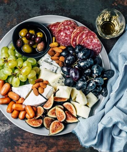 Cheese platter (cheese, olives, figs, salami, almonds, and grapes), food, cocktail hour, wine