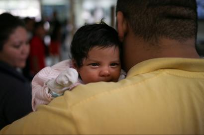 An undocumented immigrant father with his infant daughter