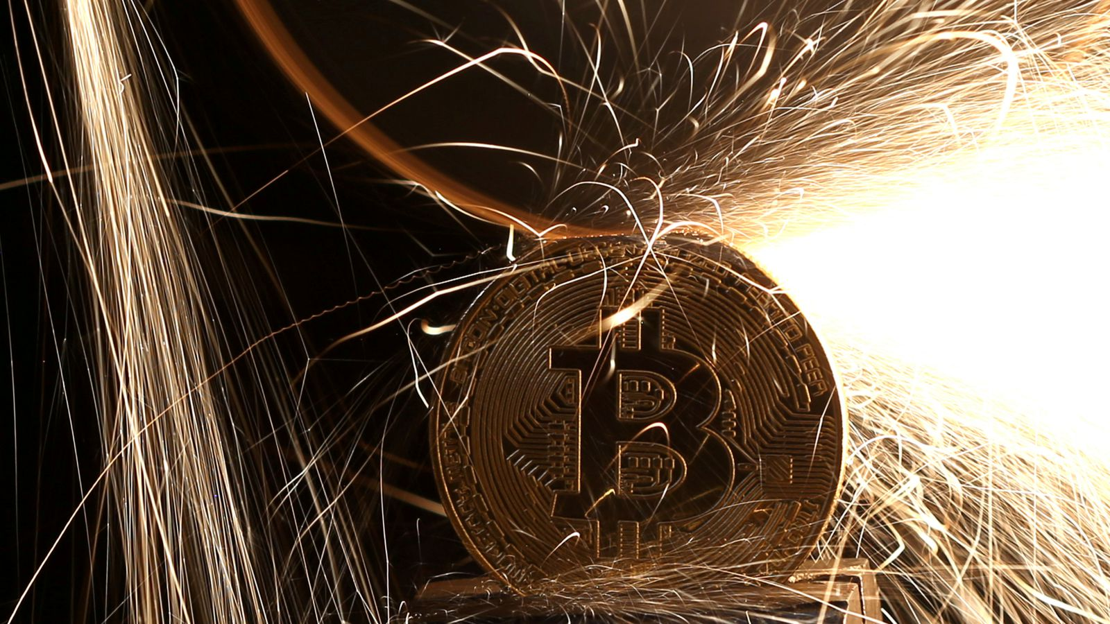 Sparks glow from broken Bitcoin (virtual currency) coins in this illustration picture, December 8, 2017. Picture taken December 8