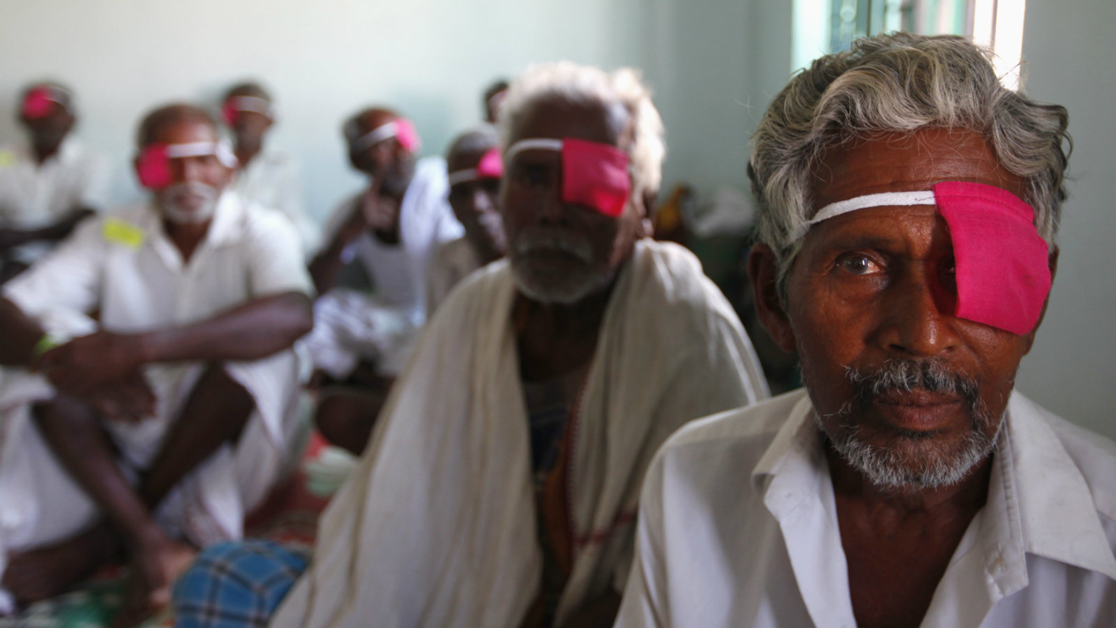 Patients with their eyes bandaged sit after their cataract surgeries at a hospital of the Aravind Eye Care System in Madurai, in India's Tamil Nadu state March 3, 2010. From a rented house with 11 beds in 1976, Aravind, whose mission is to eliminate needless blindness, has grown into a network of hospitals and clinics that provides eye examinations, surgery by keeping its costs extremely low and by subsidizing care for poor people through fees for paying customers and the sale of eye-care products. Picture taken March 3, 2010.