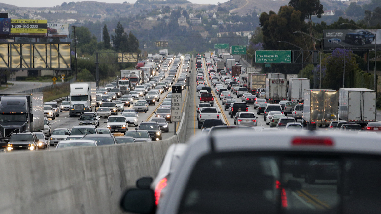 In this Friday, May 22, 2015 photo, traffic moves along the 60 Freeway during rush hour in Rowland Heights, Calif. Traffic congestion will become significantly worse and more widespread without big changes in how people and products get around. The possible solutions are many, but none is easy or cheap. (AP Photo/Jae C. Hong)