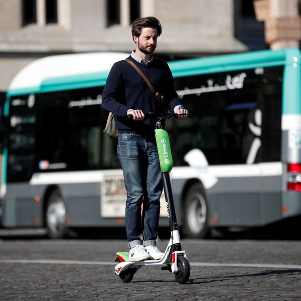 Lime's France director Arthur-Louis Jacquier rides a dock-free electric scooter Lime-S by California-based bicycle sharing service Lime on their launch day in Paris, France, June 22, 2018. REUTERS/Benoit Tessier - RC1121356D40