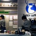 Workers make coffee at a branch of the Chinese coffee chain Luckin Coffee in Beijing, China, in May 2018. Luckin is now valued at $1 billion as it takes on Starbucks.