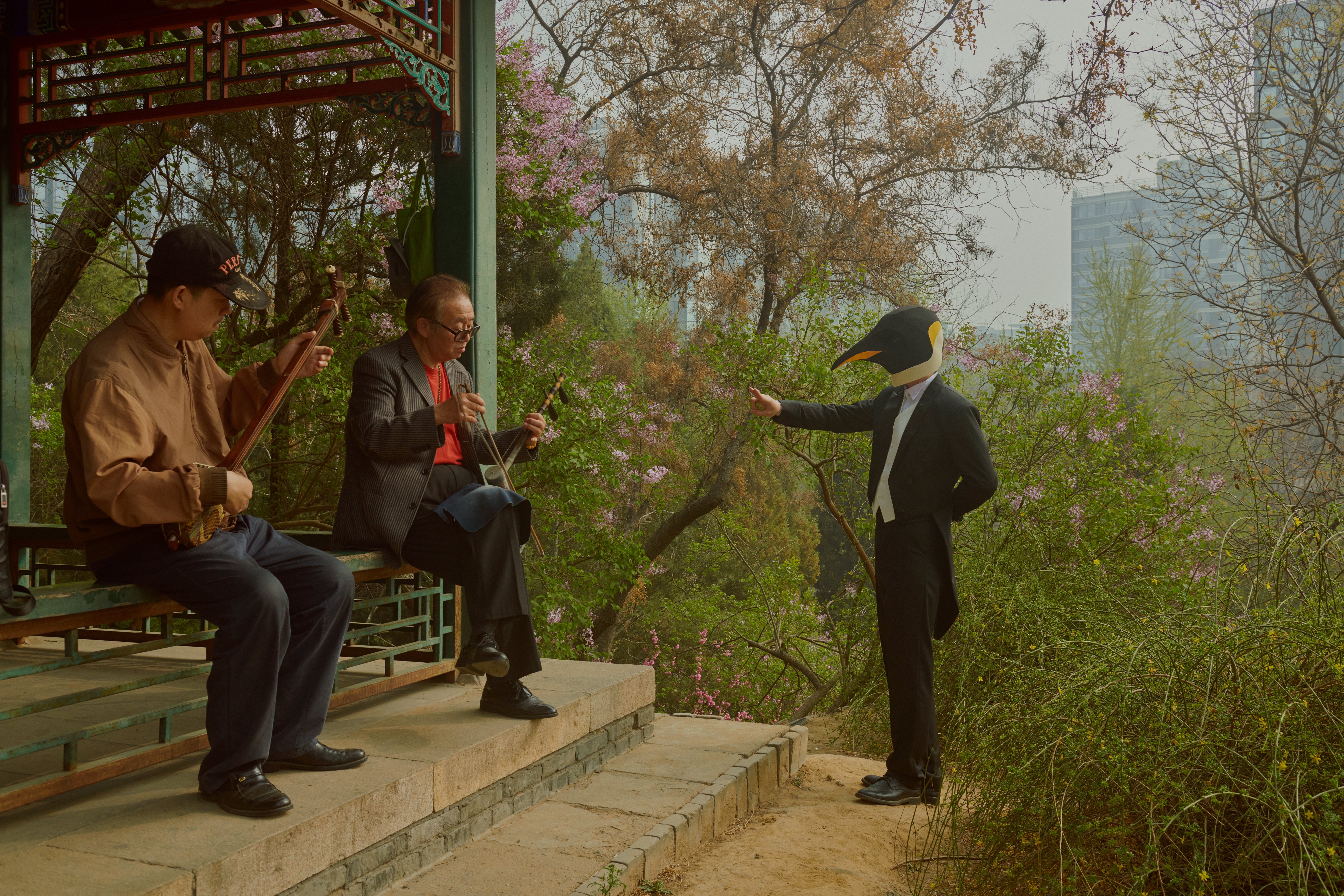 This corner in a park says a lot about China, Xu said. It shows a typical daily routine of a retired man, who visits a park and sings Beijing opera while playing an urhu, a traditional string instrument, inside a pavilion. There's a skyscraper in the distance.