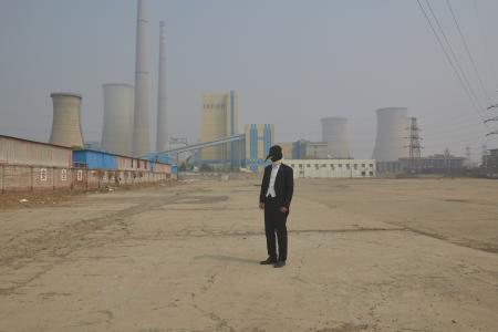 The penguin man visits a thermal plant which provides heating for the city.