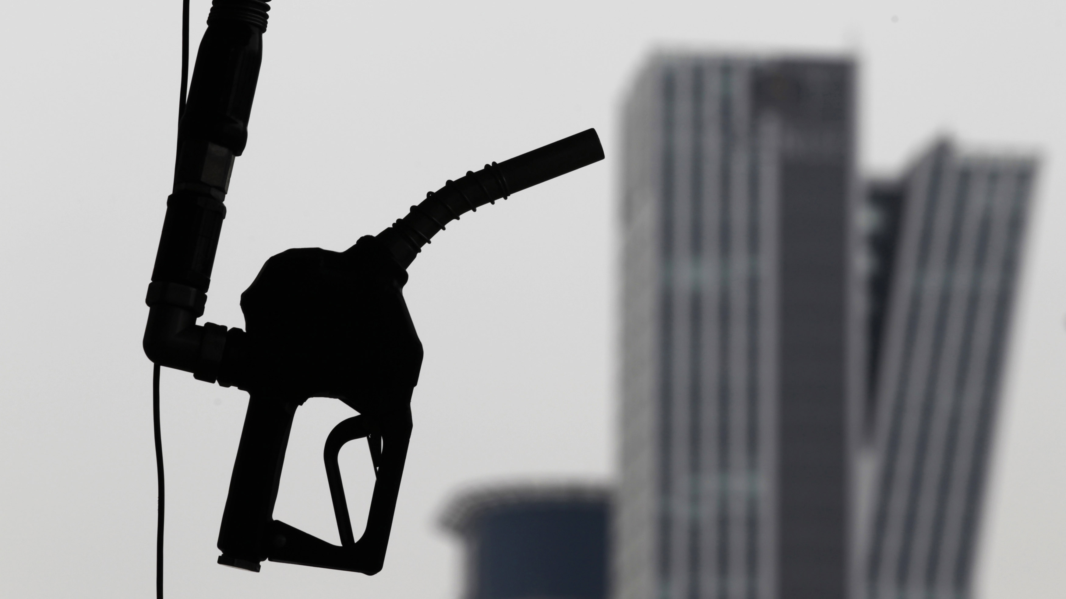 A gasoline pump is seen hanging at a petrol station in central Seoul April 6, 2011. South Korea's government said in a statement on Wednesday that it will consider cutting oil taxes if crude prices rise further, without giving details. The announcement came soon after the country's smallest crude oil refiner joined three other refiners in lowering gasoline and diesel prices to help the government curb domestic inflation.   REUTERS/Lee Jae-Won (SOUTH KOREA - Tags: BUSINESS ENERGY) - GM1E74615N501