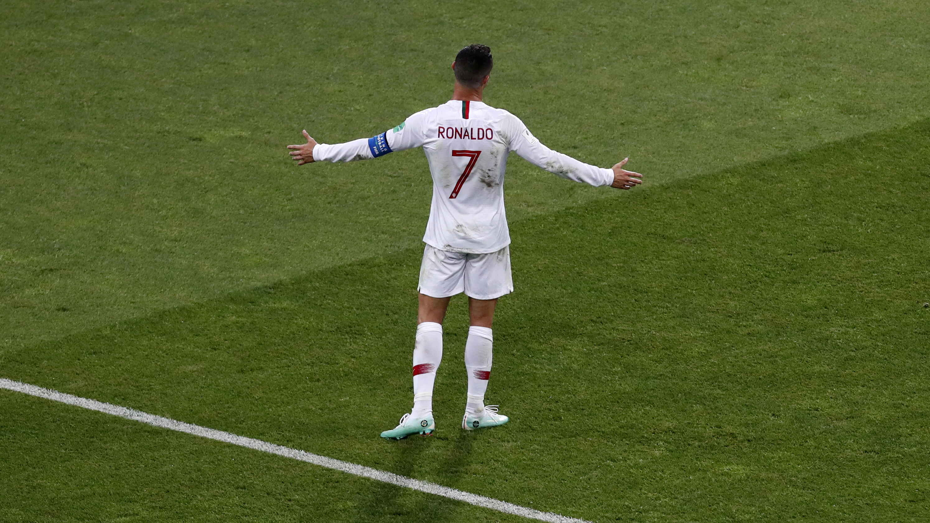 Portugal's Cristiano Ronaldo spreads his arms during the round of 16 match between Uruguay and Portugal at the 2018 soccer World Cup at the Fisht Stadium in Sochi, Russia, Saturday, June 30, 2018. (AP Photo/Darko Vojinovic)
