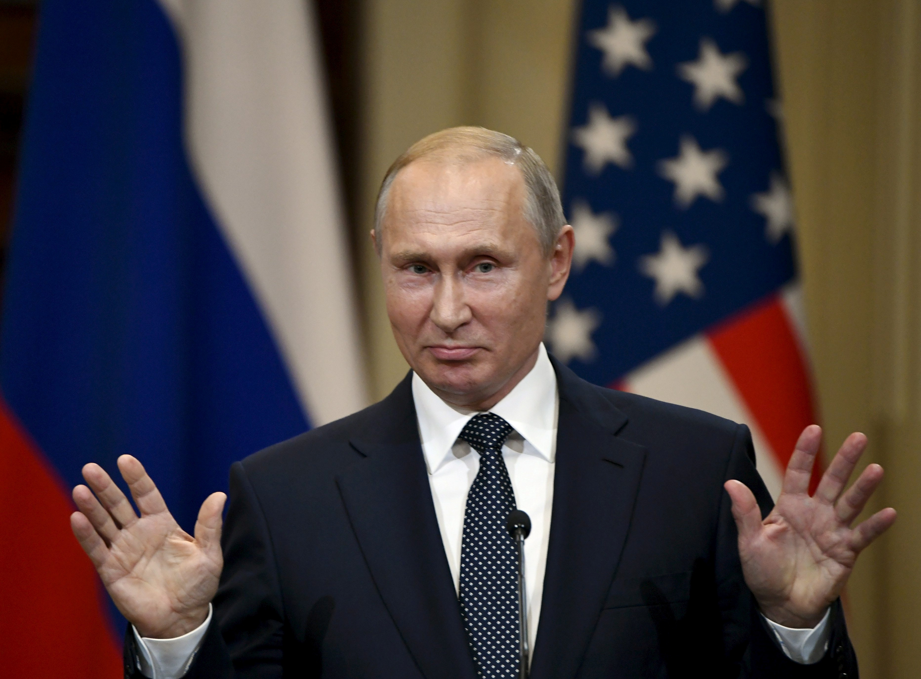 Russia's President Vladimir Putin gestures during the joint press conference with U.S. President Donald Trump in the Presidential Palace in Helsinki, Finland July 16, 2018. Lehtikuva/Jussi Nukari via REUTERS ATTENTION EDITORS - THIS IMAGE WAS PROVIDED BY A THRID PARTY. FINLAND OUT. NO THIRD PARTY SALES. - RC1B96AA9050