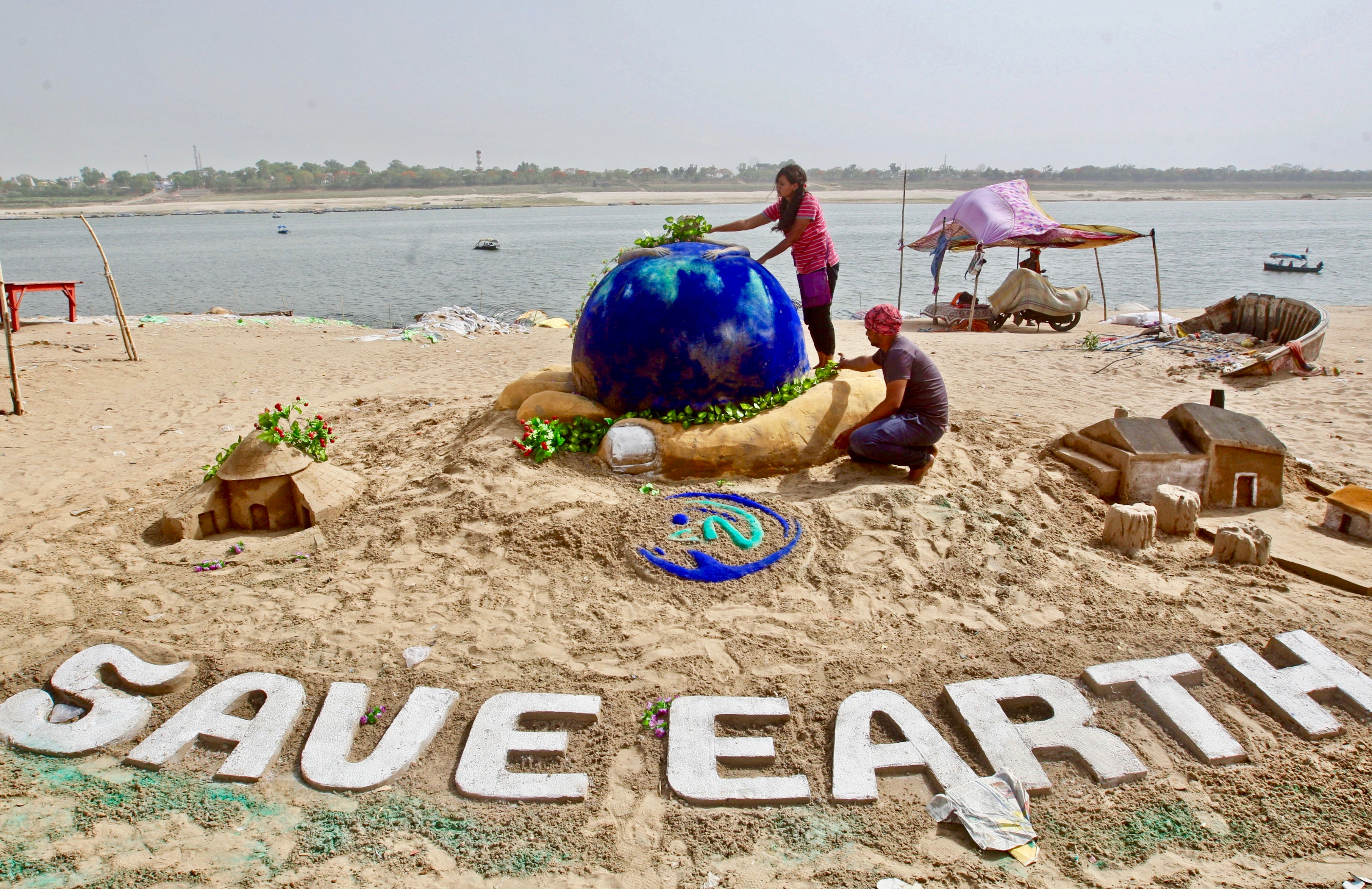 Earth Day 2018 sand sculpture on the banks of the river Yamuna in Allahabad, India.