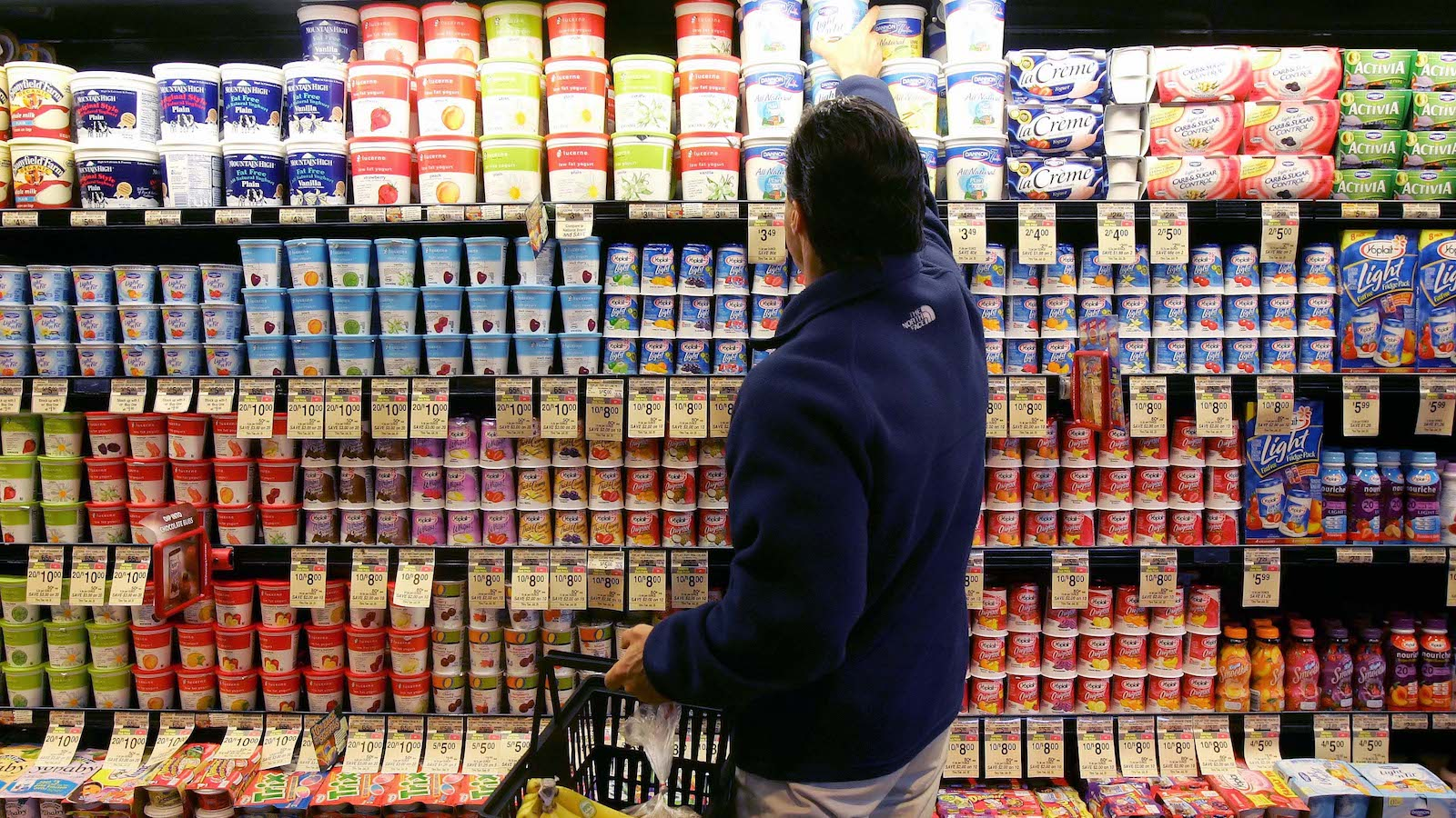 **FILE** A man shops in the yogurt aisle at a Safeway store in San Francisco in this July 18, 2006 file photo. Grocery store chain Safeway Inc. said Thursday its fourth-quarter profit climbed 78 percent on higher revenue and a tax gain. (AP Photo/Jeff Chiu, file)