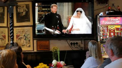 British tourists watch Britain's Prince Harry and Meghan Markle's wedding on a television at a restaurant in the British overseas territory of Gibraltar, historically claimed by Spain May 19, 2018.