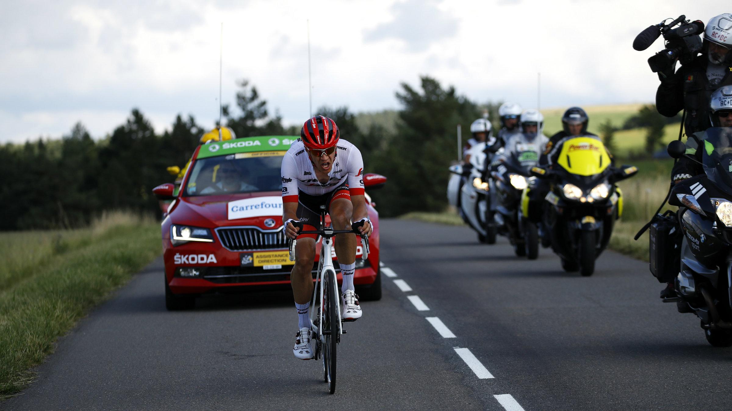 Cyclist in the Tour de France followed by cameramen