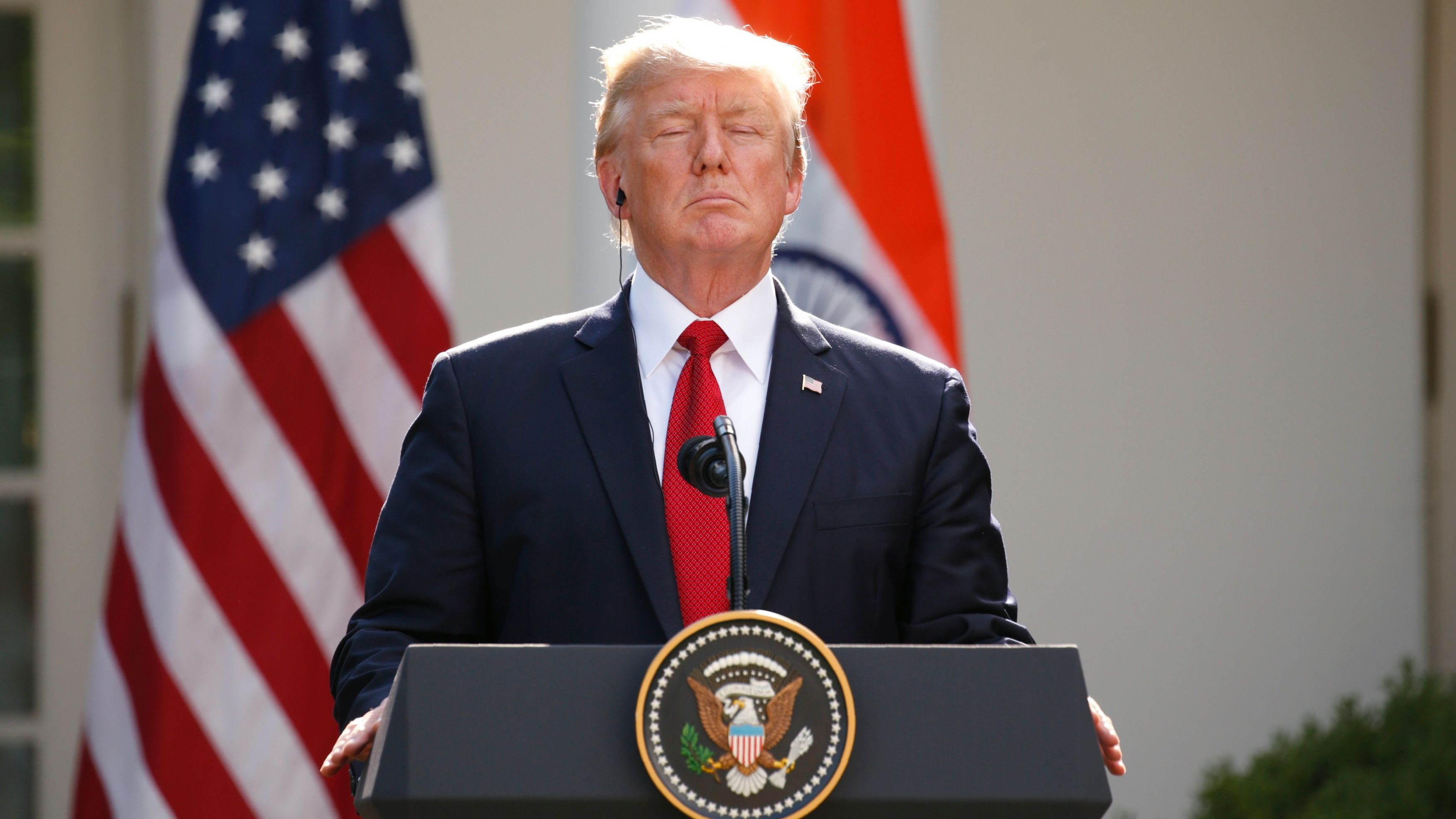 US President Trump pauses during joint news conference with Indian Prime Minister Modi in the Rose Garden of the White House in Washington