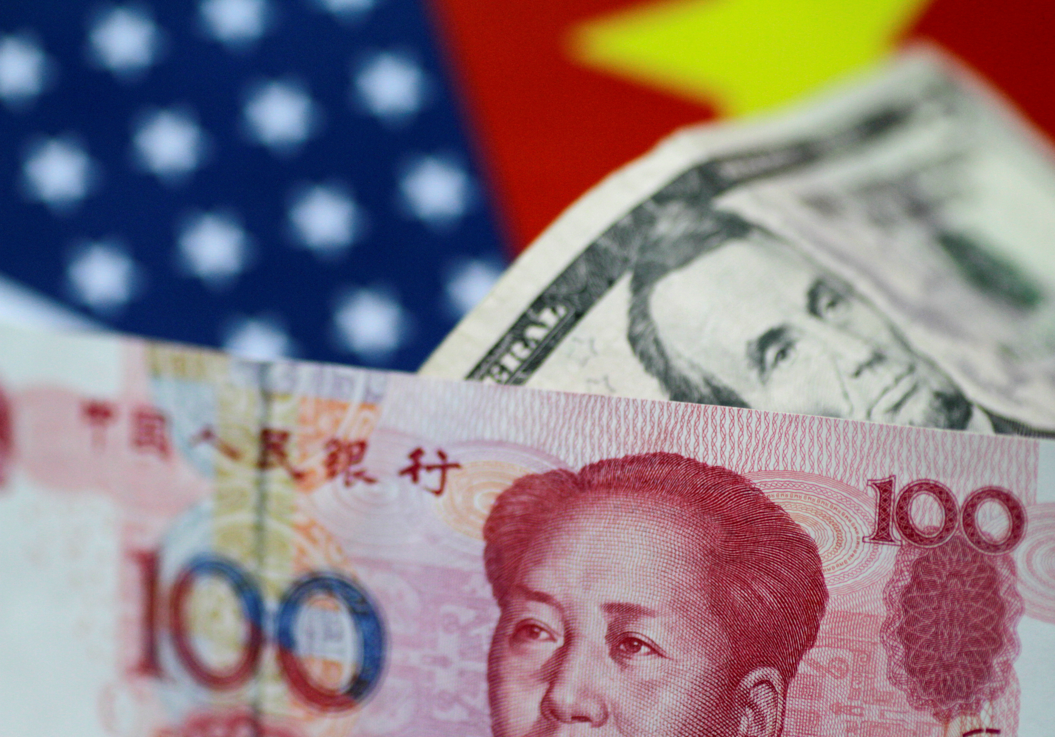 FILE PHOTO: U.S. Dollar and China Yuan notes are seen in this picture illustration June 2, 2017. REUTERS/Thomas White/Illustration/File Photo - RC15903660F0