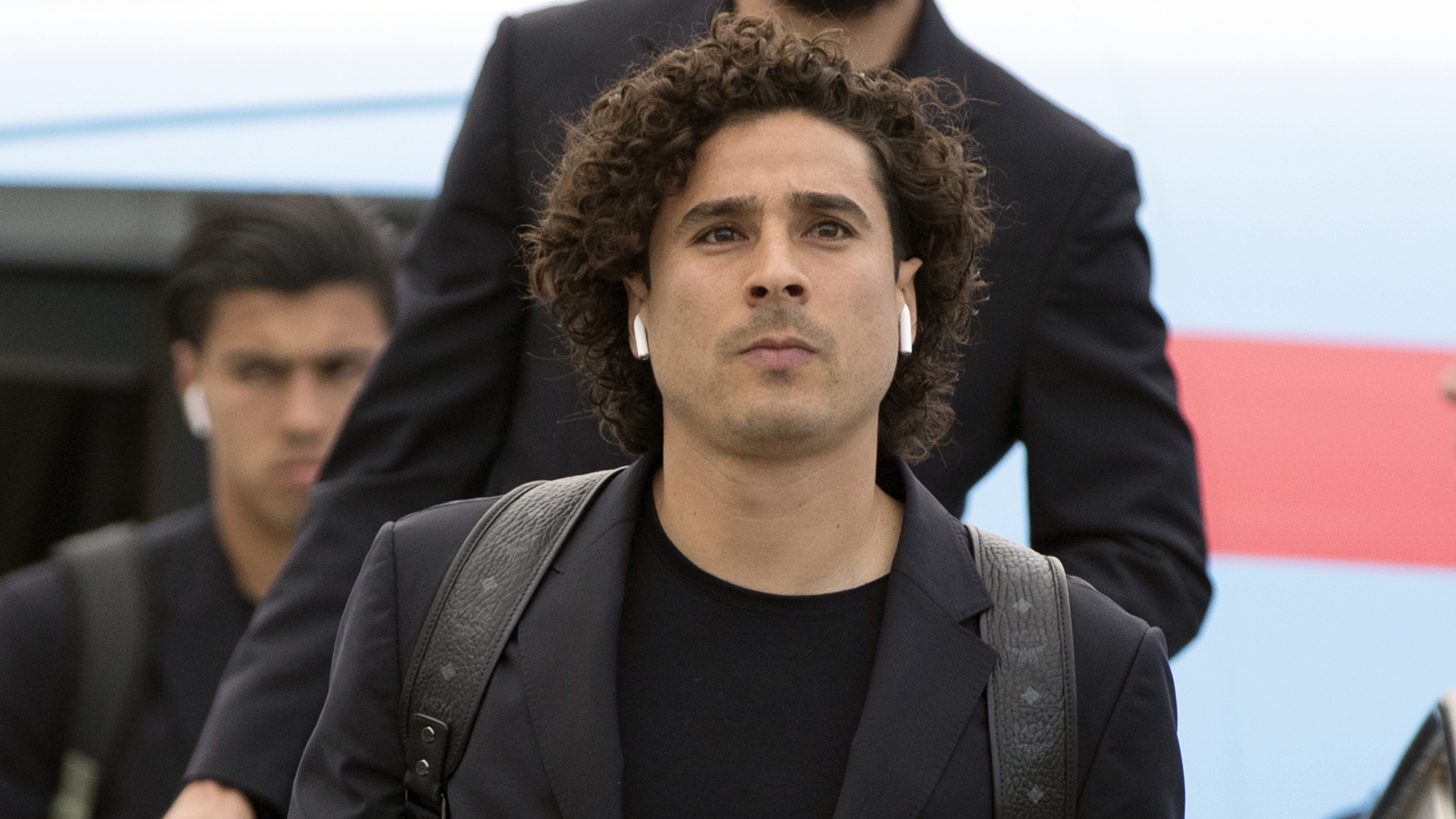 Guillermo Ochoa disembarks the plane as the Mexico national soccer team arrive at the Sheremetyevo international airport, outside Moscow, Russia, Monday, June 11, 2018 to compete in the 2018 World Cup in Russia. The 21st World Cup begins on Thursday, June 14, 2018, when host Russia takes on Saudi Arabia. (AP Photo/Pavel Golovkin)