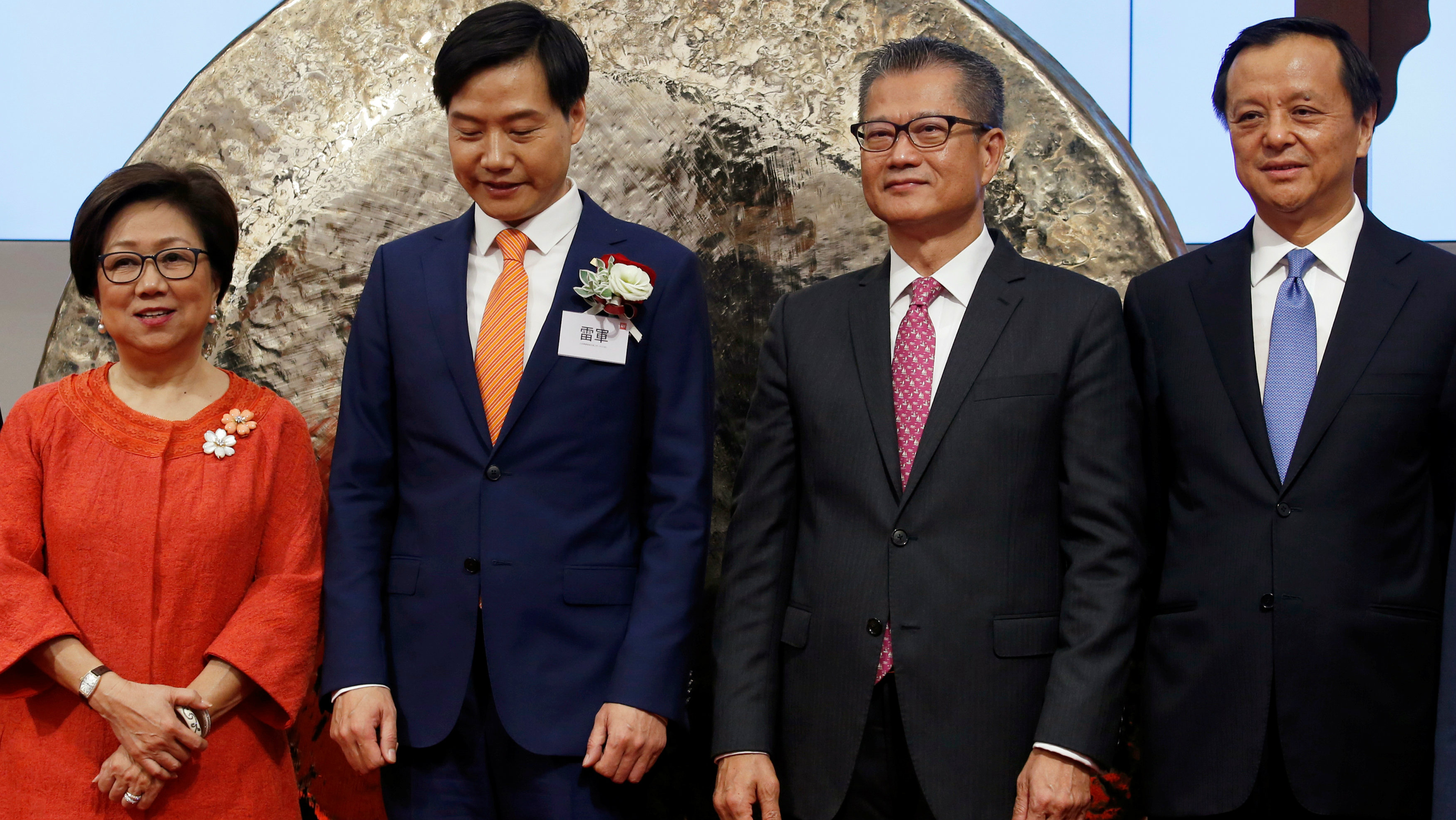 Hong Kong Exchanges and Clearing Chairman Laura Cha, Xiaomi founder, Chairman and CEO Lei Jun, Hong Kong Financial Secretary Paul Chan and Hong Kong Exchanges and Clearing Chief Executive Charles Li attend the listing of Xiaomi at the Hong Kong Exchanges in Hong Kong, China July 9, 2018.