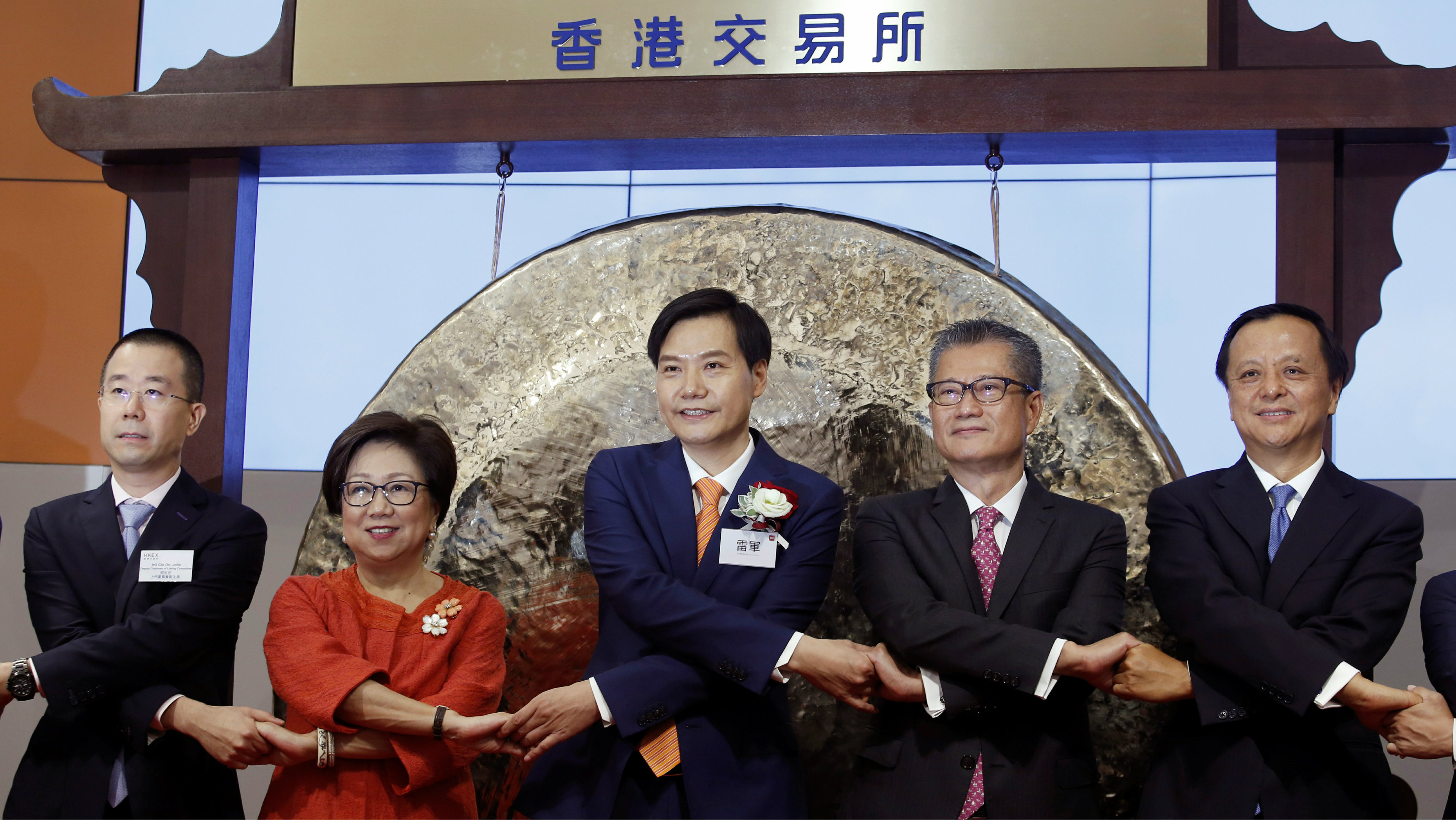Xiaomi founder, Chairman and CEO Lei Jun (C) attends the listing of the company with Hong Kong Exchanges and Clearing Chairman Laura Cha (2nd L), Financial Secretary Paul Chan (2nd R) and Hong Kong Exchanges and Clearing Chief Executive Charles Li (R) at the Hong Kong Exchanges in Hong Kong, China July 9, 2018.