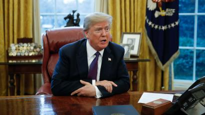 US president Donald Trump sits at his desk in the Oval Office.