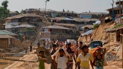 In this Saturday, April 28, 2018, photo, Rohingya refugees rebuild their makeshift houses, in preparation for the approaching monsoon season at the Kutupalong Rohingya refugee camp in Kutupalong, Bangladesh. Rohingya refugees who fled Myanmar during a brutal crackdown now face a new danger: rain. The annual monsoon will soon sweep through camps where some 700,000 Rohingya Muslims live in huts made of bamboo and plastic built along steep hills.