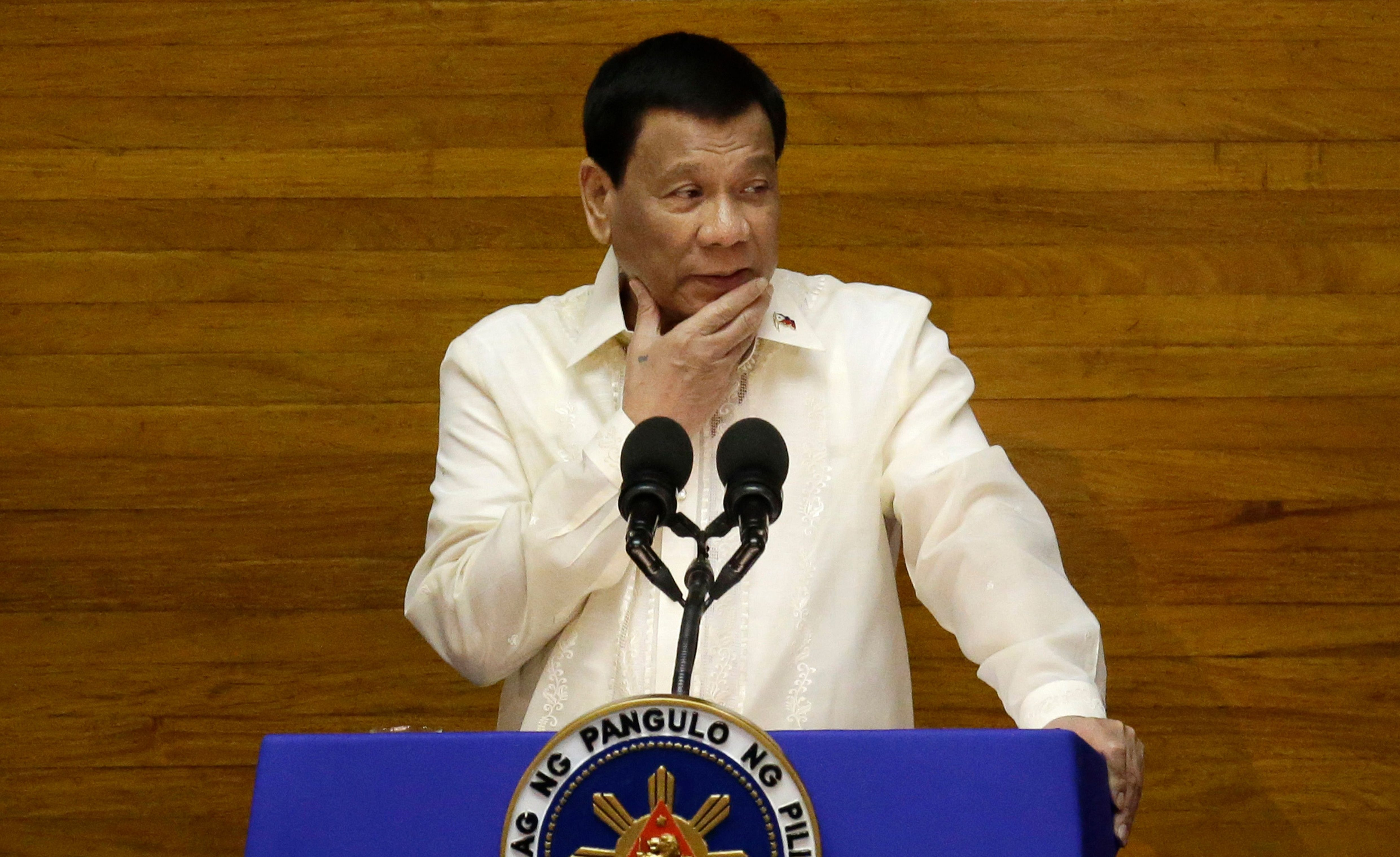 Philippine President Rodrigo Duterte pauses during his third State of the Nation Address at the House of Representatives in Quezon City, Manila, Philippines Monday, July 23, 2018.