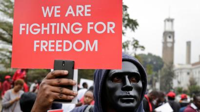 Kenyan activists and civil society groups protest in solidarity with Ugandan pop star-turned-lawmaker Kyagulanyi Ssentamu, also known as Bobi Wine, in a march to the Ugandan embassy in Nairobi, Kenya Thursday, Aug. 23, 2018. Bobi Wine, who opposes Uganda's longtime president Yoweri Museveni, was charged with treason in a civilian court in Gulu, Uganda on Thursday, minutes after a military court dropped weapons charges.