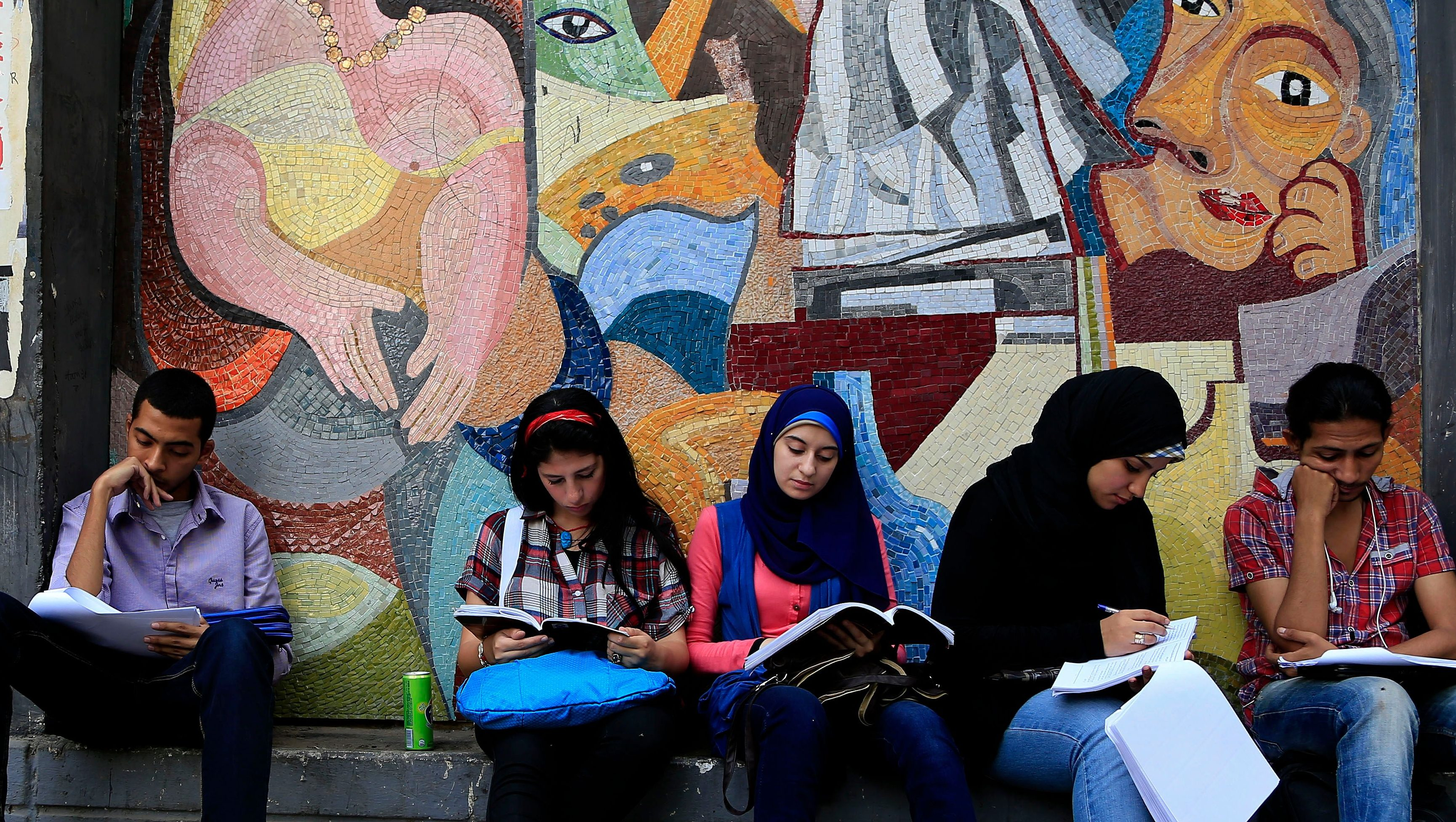 Art students from the University of Helwan study outside their university for their final year exams in the Zamalek neighborhood of Cairo, Egypt, Sunday, June 2, 2013.