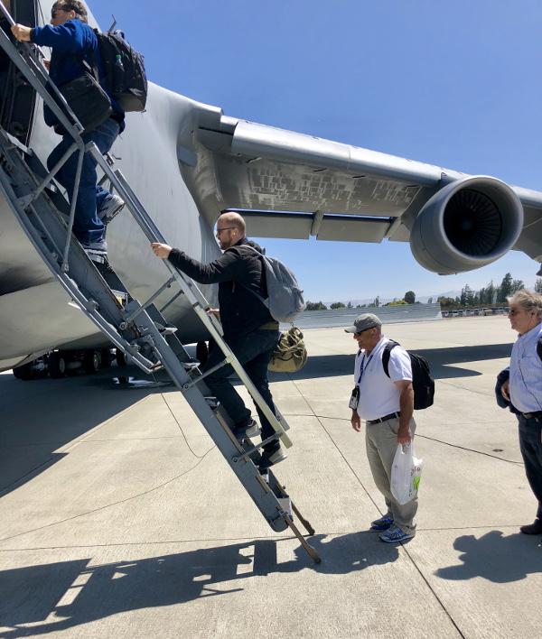 Passengers board a C-5 Galaxy at Moffett Airfield, California.