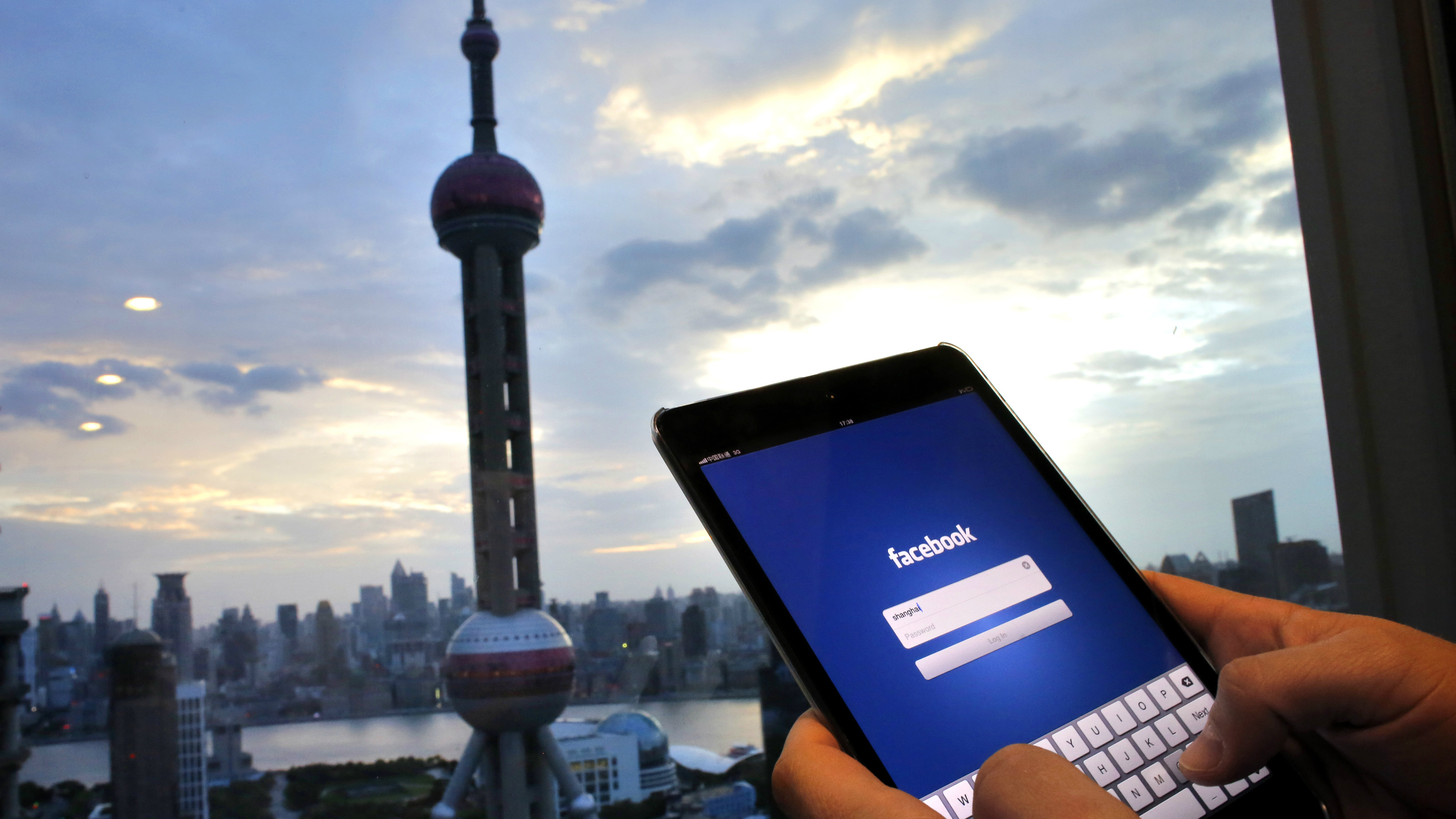 A person looking at Facebook on their phone in China.