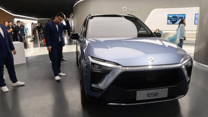 """NIO ES8, an all-electric sport utility vehicle, is displayed inside a NIO House """"brand experience"""" store, in Beijing, China November 25, 2017. REUTERS/Norihiko Shirouzu"""