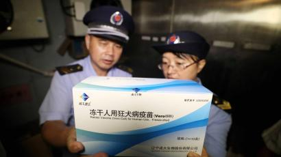 Law enforcement personnel from the market supervision and administration bureau check the vaccine supply in Rongan, China, 23 July 2018. Chinese Premier Li Keqiang has ordered new investigations into China's DPT vaccine scandal. Thousands of DPT vaccines, which are used to inoculate children against pertussis, diphtheria, and tetanus were found ineffective, according to the Chinese media.