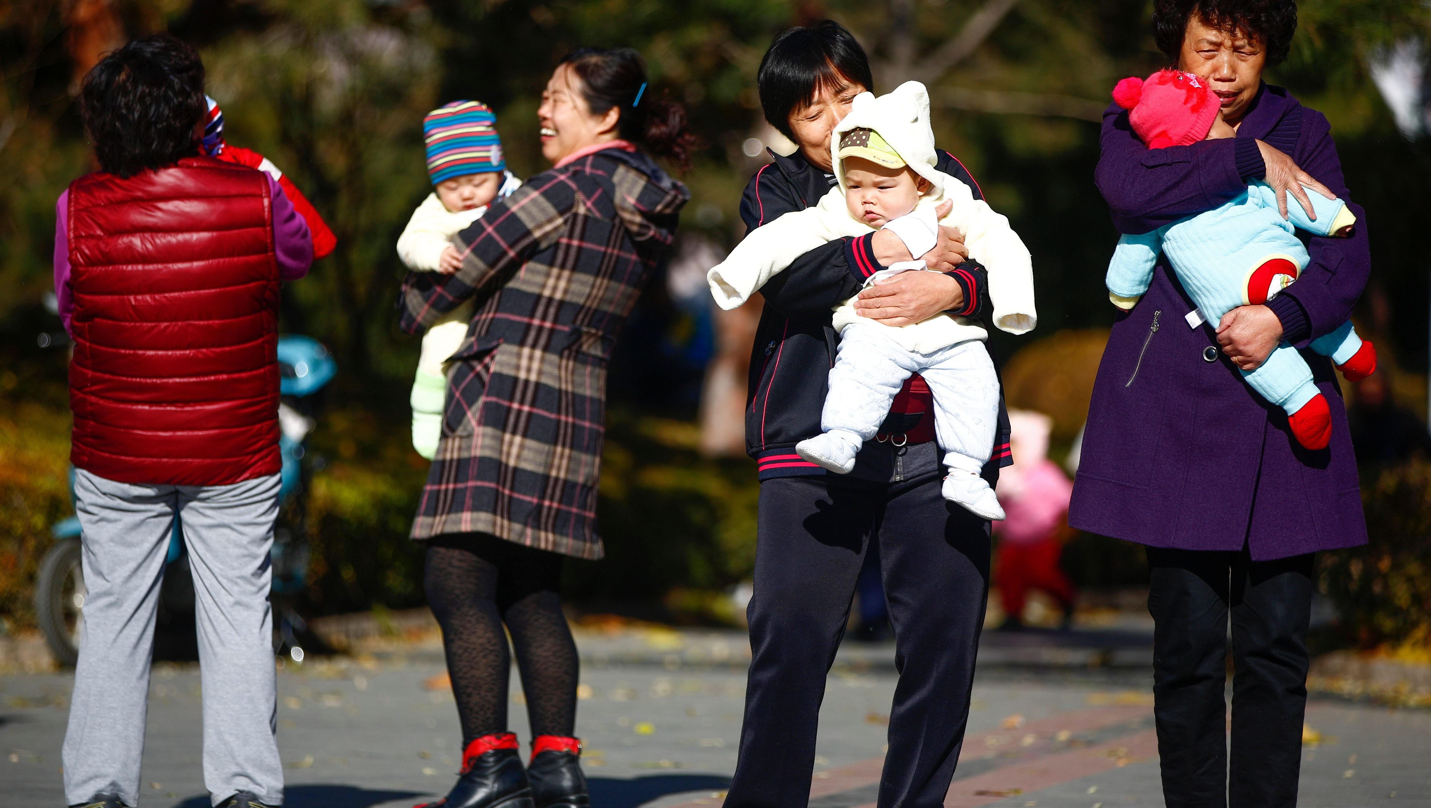 A file photo dated 25 November 2013 showing parents and babies gathering at a park in Beijing, China. China is to abolish its one-child policy, the official Xinhua news agency reported 29 October 2015 from a meeting of the Central Committee of the Communist Party in Beijing. EPA/DIEGO AZUBEL