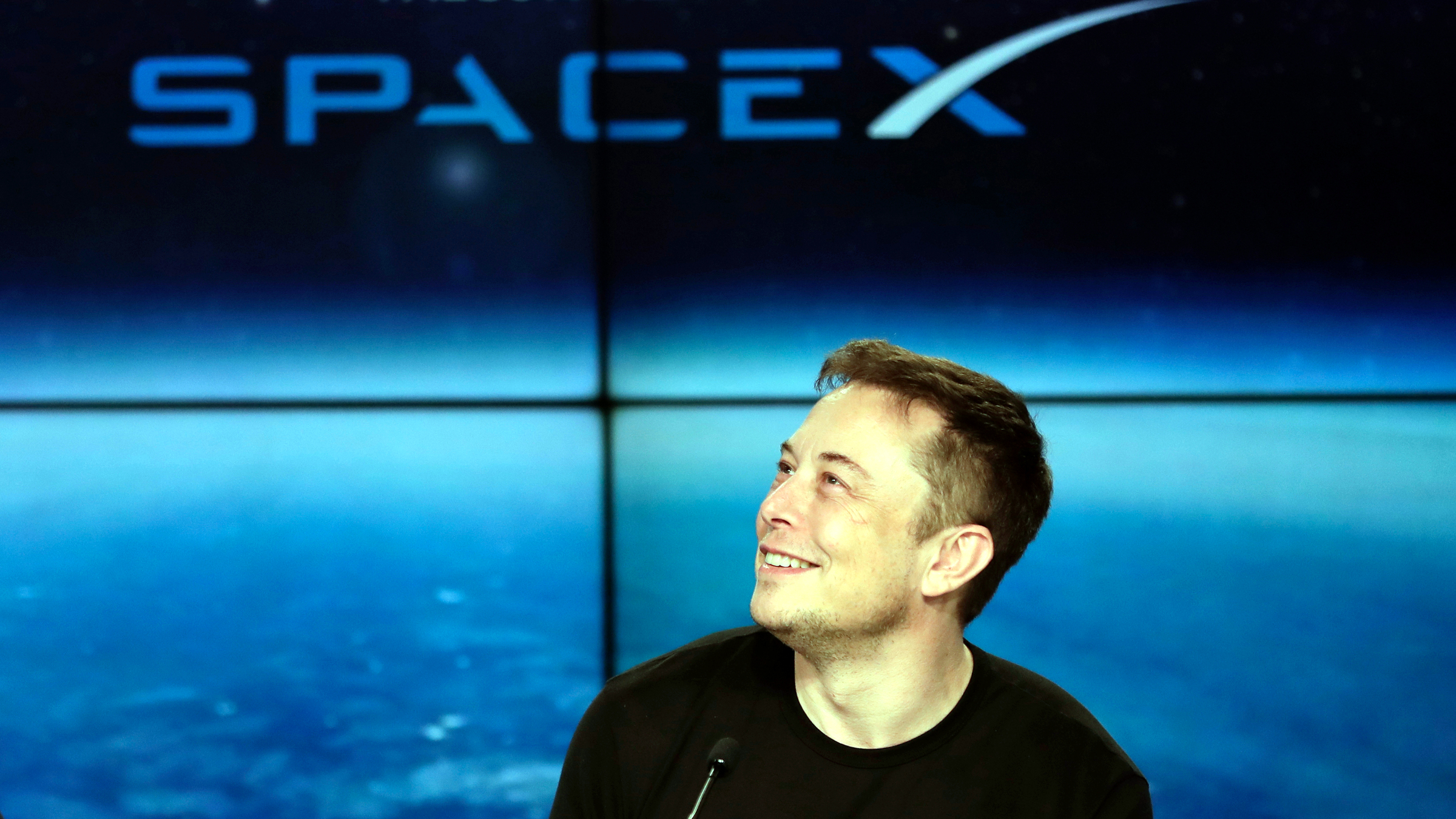 FILE - In this Feb. 6, 2018 file photo, Elon Musk, founder, CEO, and lead designer of SpaceX, speaks at a news conference after the Falcon 9 SpaceX heavy rocket launched successfully from the Kennedy Space Center in Cape Canaveral, Fla. A committee of the Los Angeles City Council on Wednesday, April 18, approved an environmental review exemption for a Los Angeles-area tunnel that Elon Musk wants to dig to test a novel underground transportation system.