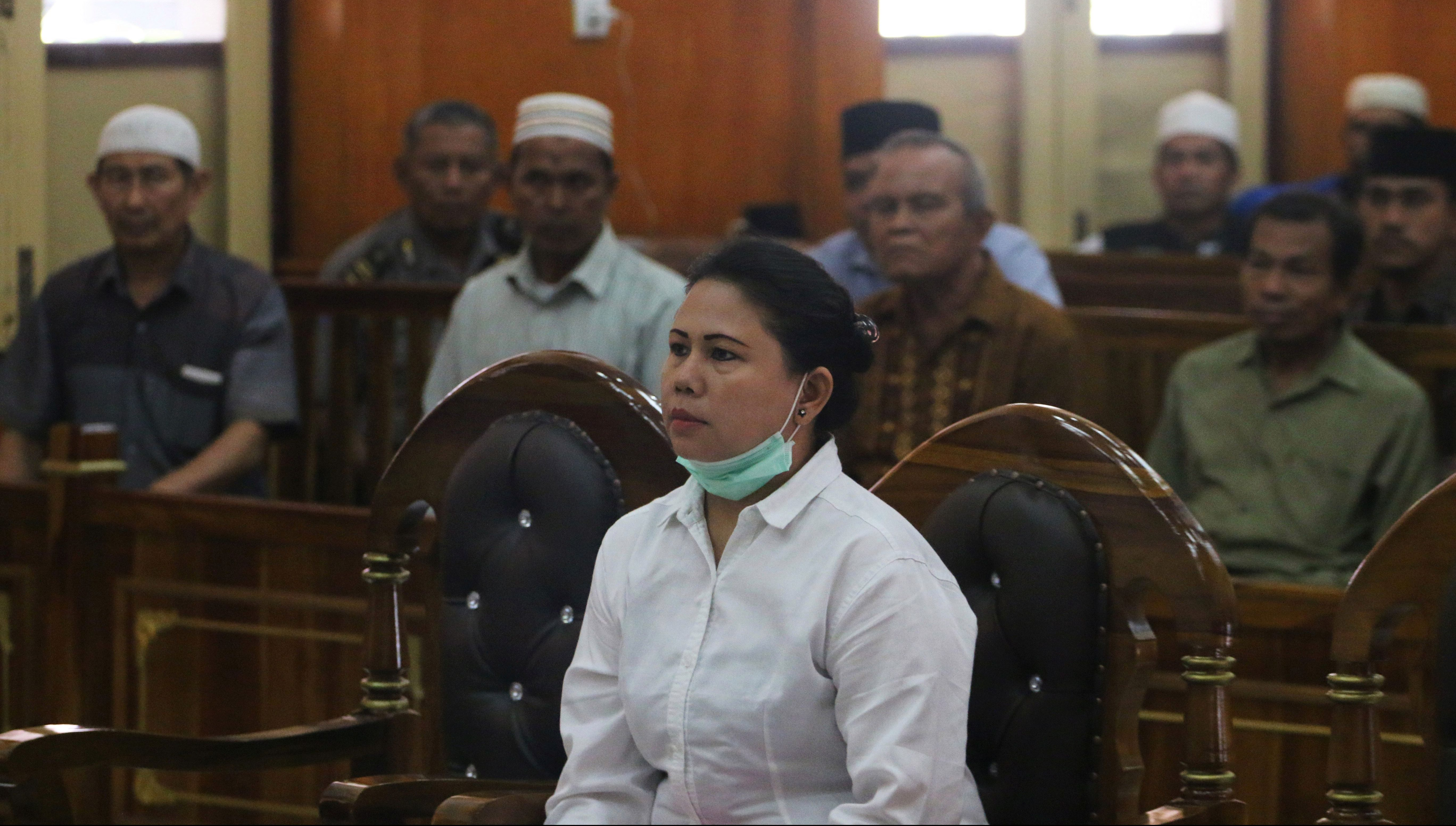 Meiliana, a 44-year-old ethnic Chinese Buddhist, sits in a courtroom for blasphemy charges, in Medan, Sumatra, Indonesia August 21, 2018.
