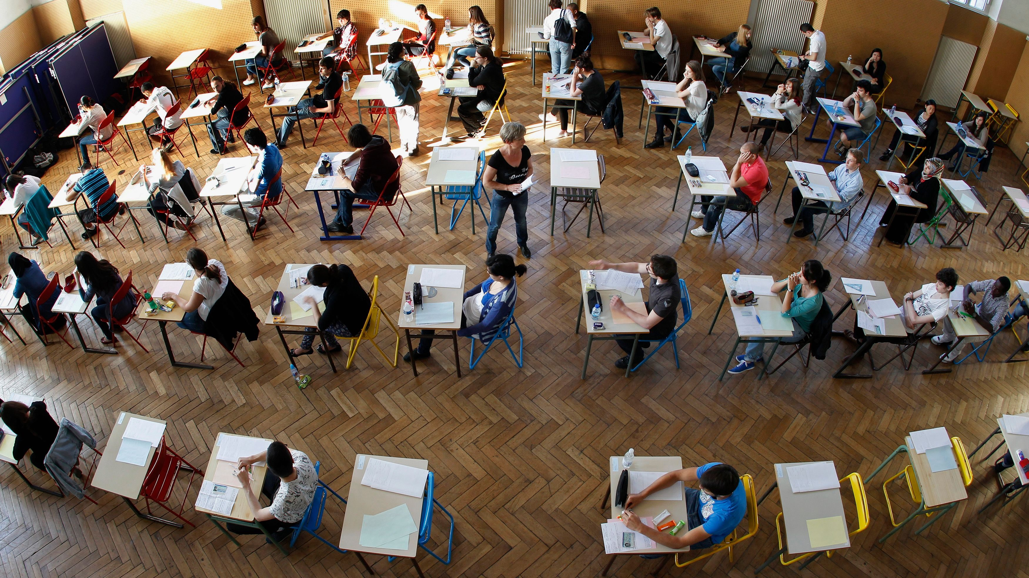 An overhead view of students taking an exam