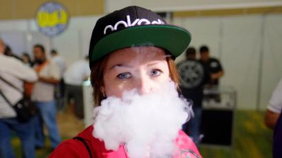 "A participant vapes, exhales vapor produced by an electronic cigarette or a vape, during the vape competition ""Cloud chasing"" at the Vape Trade Convention (VTC) in Mexico City, Mexico June 10, 2017. Picture taken June 10, 2017. REUTERS/Victor Ruiz Garcia TPX IMAGES OF THE DAY - RC175ECDC130"