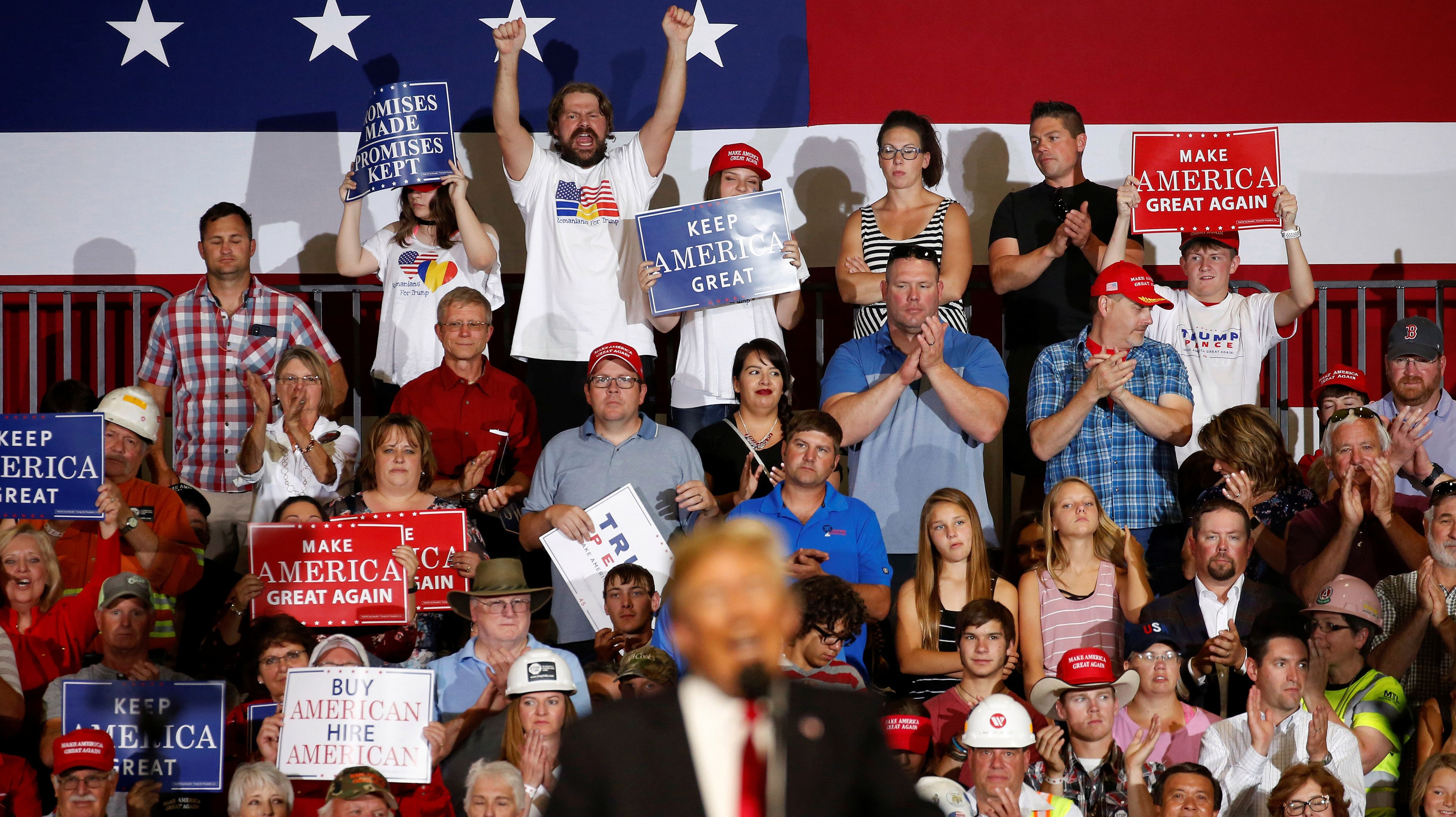Supporters cheer as U.S. President Donald Trump speaks during a Make America Great Again rally