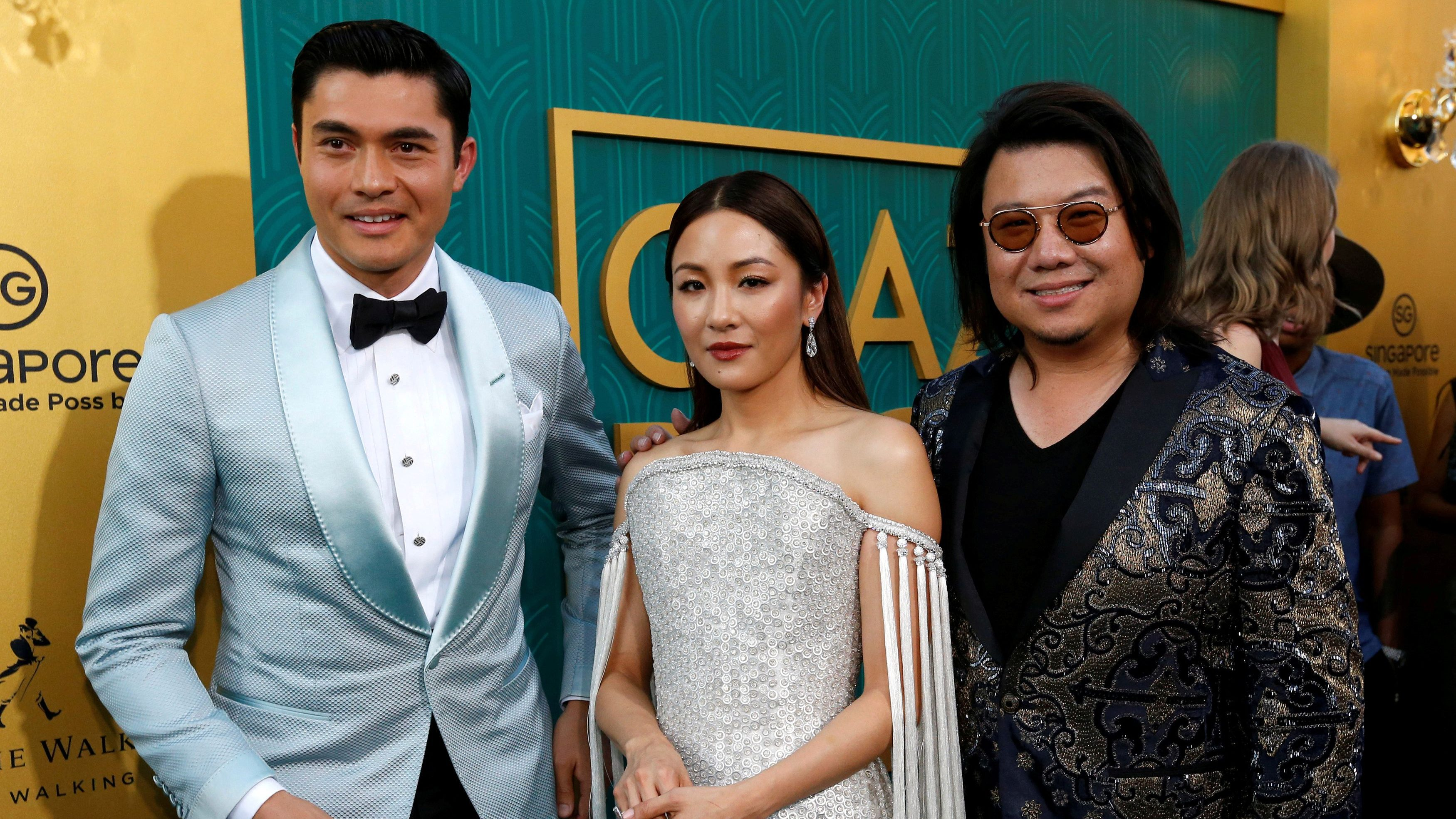 "Author Kevin Kwan (R) and cast members Henry Golding and Constance Wu pose at the premiere for ""Crazy Rich Asians"" in Los Angeles, California, U.S., August 7, 2018."