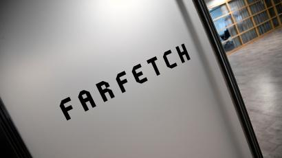 FILE PHOTO: Branding for online fashion house Farfetch is seen at the company headquarters in London, Britain January 31, 2018. REUTERS/Toby Melville/File Photo - RC123A8191A0