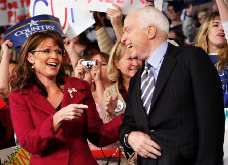 U.S. Republican vice-presidential nominee Alaska Governor Palin and U.S. Republican presidential nominee Senator McCain (R-AZ) share a laugh at a campaign rally in Hershey